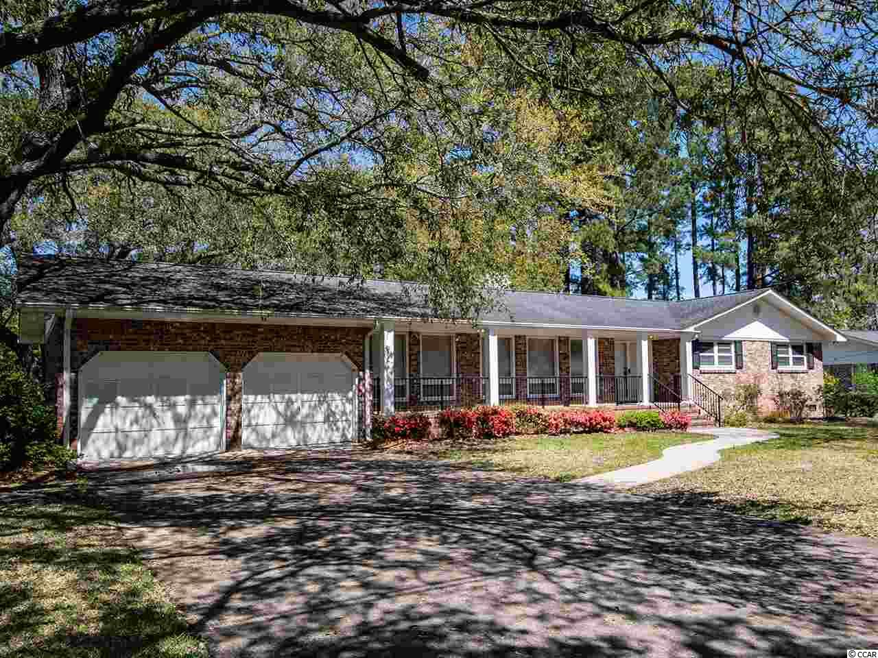 Location, location, location...Country Club Estates:  Only minutes from the Historic District of Georgetown, SC, water front dining, shopping, area beaches and several water ways. This 4 bedroom 2-1/2 bath ranch has the perfect location to be within reach of everything yet still enjoy a quiet neighborhood.