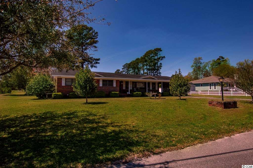 Properties like this do not come on the market often, This all brick gem is spacious with 1900 heated square feet, and sits on .71 of an acre - the lot size is 156 x 197 so you have plenty of room to roam, park your boat, park your trailer, or golf-cart and motorcycle!... NO HOA - The home is only a few blocks to public boat ramp, you can ride your golf-cart to the beach, you can get to shopping, restaurants and entertainment in seconds and do not have to get on Hwy 17, Home has great potential and just needs some updating, the possibilities are great, the back yard is big enough for your own oasis by adding a pool, outdoor living and outdoor kitchen - you name it you can make it happen, you got room to add a 3 car garage it you need it, Home has great curb appeal with large front porch and 1 car carport. Home features a laundry room, dining room, very large living room, den, foyer, three bedrooms and two baths! So calling all you HGTV fans this one is for you!!! Grab your camera to take the before pictures and take pride in making this home something to brag about! The community is an old neighborhood in Little River that still has some true local families still living there, again its not often to find a home in Willard's Subdivision for sale - so lets just say I know for sure this gem will not last long... so you better hurry!