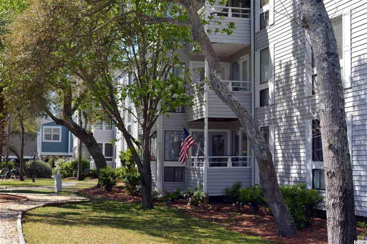 This bright, airy two bedroom condo in Arcadian Dunes is just steps from the beach in the Shore Drive section between Myrtle Beach and North Myrtle Beach. Its located in a sought-after location within this popular resort - a first floor unit very close to the ocean end of the complex, overlooking a pool area (See site plan in pictures). Furnished and accessorized with a full kitchen and washer/dryer for your convenience. Arcadian Dunes is a well maintained resort with two pools, a playground, on-site restaurant/lounge, hot tub, grilling and picnic area, fitness room, and tennis court. Located close to shopping, dining, golf, entertainment, and all area attractions. Near Restaurant Row, the Tanger Outlets, Barefoot Landing, Ocean Annies, and Apache Pier (the longest wooden pier on the east coast). HOA fee includes water/sewer and cable, as well as building insurance. All information is deemed correct, but it is the responsibility of the buyers and their agent to verify all information.