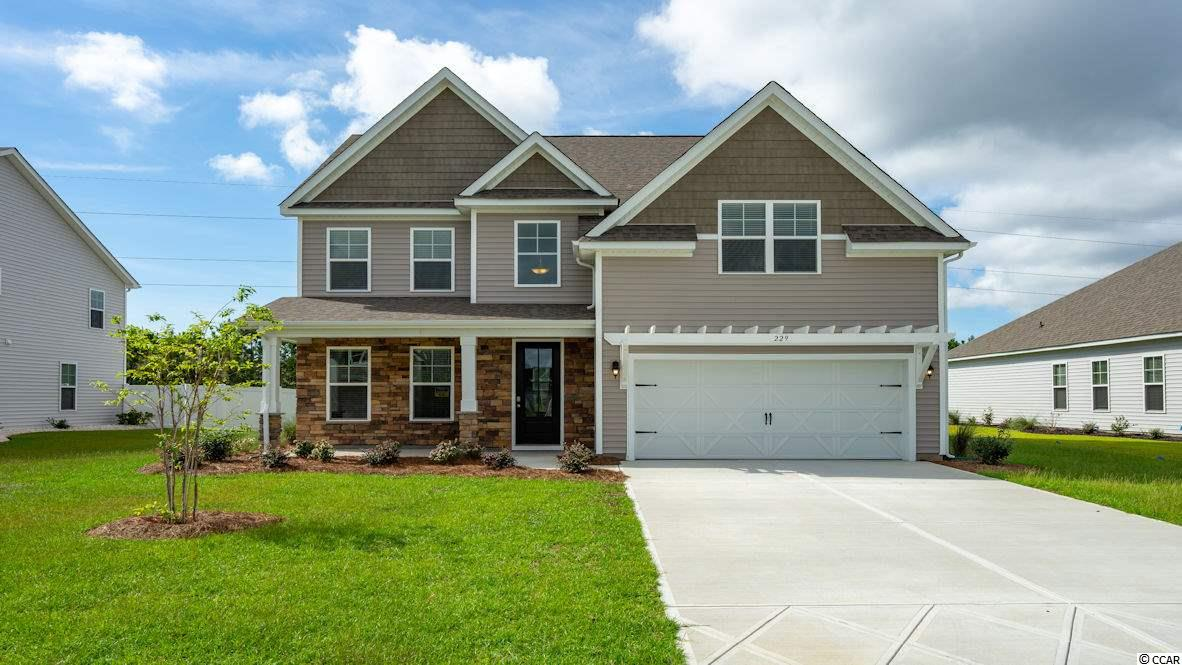 """Inlet Reserve is the place you want to call home! This is a natural gas community featuring 69 spacious homesites with private and pond views, conveniently tucked away in the heart of Murrells Inlet , yet just a short drive to championship golf courses, marinas, shopping, hospitals, beaches and the Marsh Walk where you'll find year round entertainment and award winning restaurants with spectacular views of the salt marsh and wild life.  If you are looking to downsize, upsize, or to add a pool and create your own outdoor living space, Inlet Reserve has the homesite and home for you.  We offer a mix of 1 story and 2 story thoughtfully designed open living floor plans, perfect for entertaining family and friends. The Forrester F is a Beautiful 2 story home with rear covered porch, 4 bedrooms, 3 bathrooms, Bonus Room with closet/5th BR and Formal Dining Room, crown molding, 5 1/4"""" baseboard and trimmed out windows, 8ft. entry door and front covered porch. This home offer a  grand open foyer, formal dining room, huge kitchen with tons of cabinet and counter space, painted maple 36"""" staggered cabinets , granite countertops and oversized gourmet island overlooking the family room, pantry, tile back splash, pendant lights and stainless steel appliances. 1st level features a an open floor plan with wood floors throughout the main living area and dining, full bath and bedroom. Oak treads and painted risers with rail and pickets take you to the 2nd level loft with 2 additional large guest bedrooms, 3rd bath, nice size laundry room and a 19'5x19'11 Bonus Room. Huge Owners Suite with tray ceilings, walk-in closet, walk-in tile shower and garden tub, double vanities and bowls. Tasteful interior touches run throughout the house to finish off this must see home. New Community by D. R. Horton in popular St. James school district. Pictures are of a previous built home and are for representation purposes only.  Estimated Completion Date of February 2019. Call and schedule your appoint"""