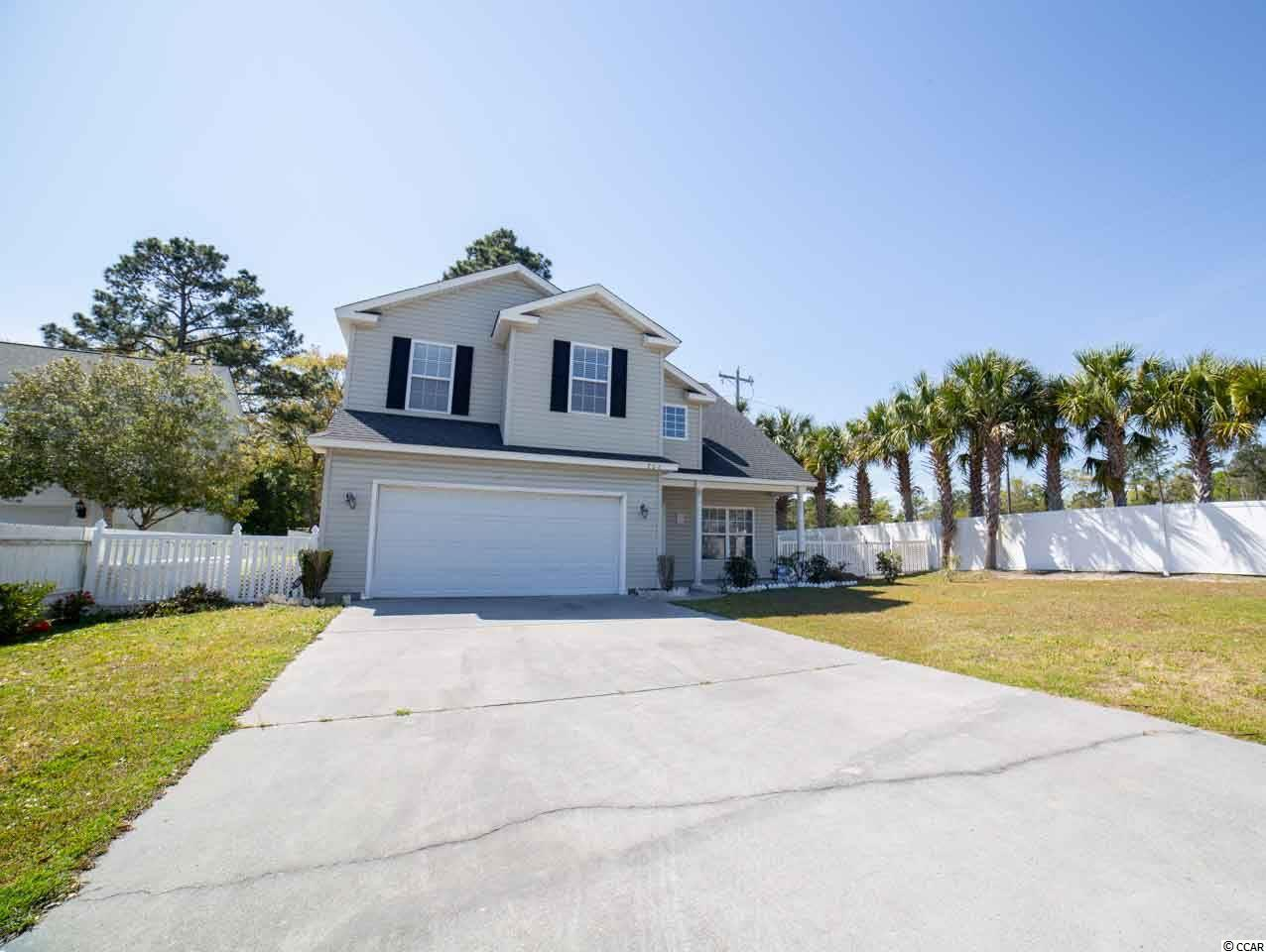 Could it be any more convenient?  Move in ready and in a fabulous location near the MarshWalk in the Inlet! An easy flow plan on the ground floor with large kitchen that features granite countertops, lots of cabinet space an upgraded appliance package and granite countertops.  The family room and dining areas are ample and open to one another and spilling out to the fenced backyard through a sliding glass door that allows for natural light. All of the bedrooms are on the second floor of the home with the master featuring an enormous walk-in closet with attic storage beyond.  The master bath has double sinks, a garden tub and a shower. The guest rooms are all nicely sized with closets that will allow for you to keep everything in order.  Let's get you moved right ... it will be an easy move to 206 Chesapeake Lane.