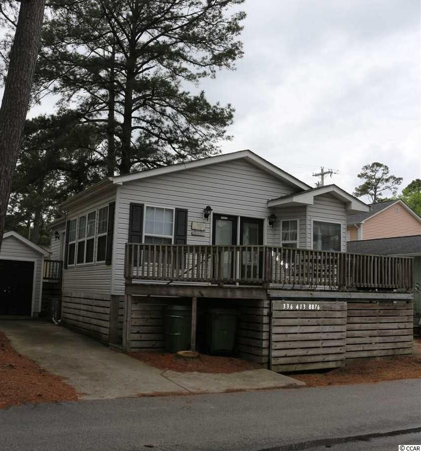 Take a look at this surprisingly spacious and very well-maintained beach cottage situated in Ocean Lakes Family Campground, one of the most popular destinations in Myrtle Beach for fun and sun. This one-owner house is light and airy with cathedral ceilings and an open floor plan. There is an alcove with two bunk beds for additional sleeping quarters. True hardwood floors in main area and ceramic tile in baths. A wonderful opportunity for someone looking for a truly turnkey property. Sold completely furnished and includes golf cart. Rental history is REALLY fantastic with remaining 2019 weeks booking fast! Rentals already booked will be transferred to and must be honored by buyer. Seller will consider owner financing for the right person.