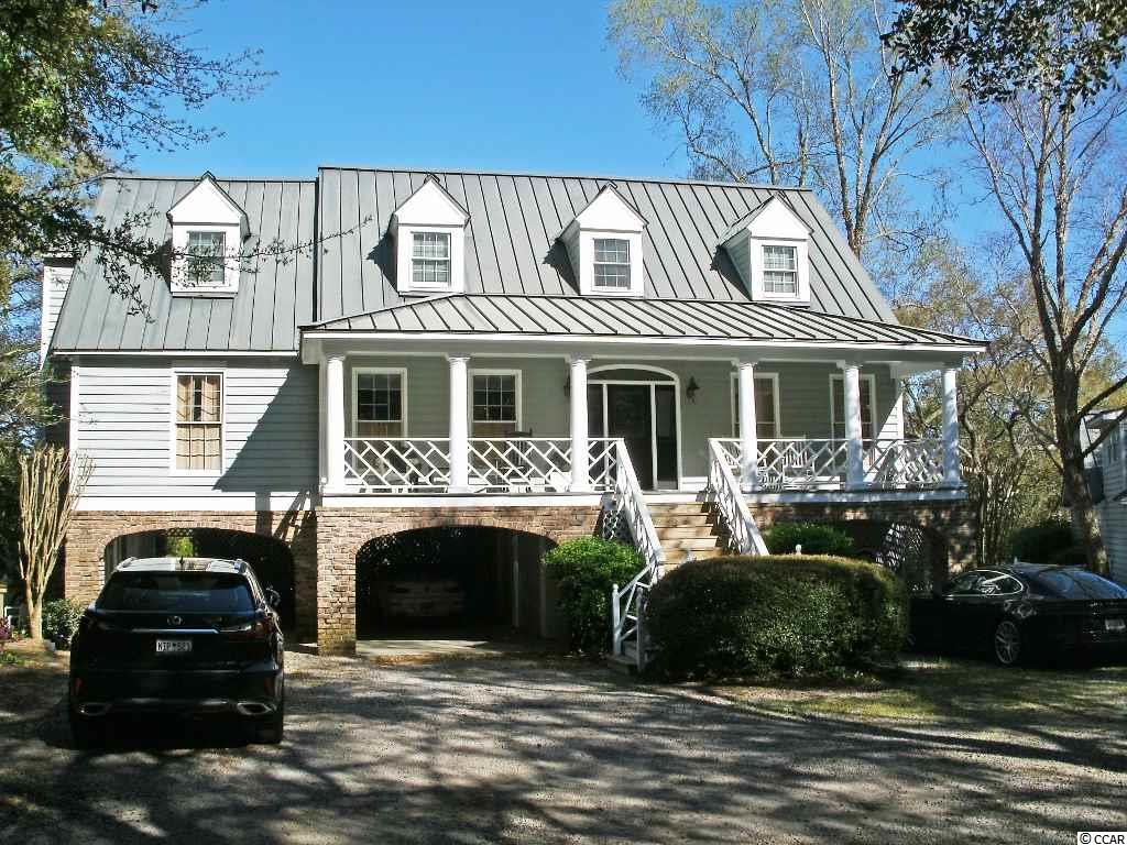 Great opportunity in the heart of Murrells Inlet. Fantastic creek front home with sweeping views and additional acreage. Fixed and floating docks. Creekside pool with waterfall and Jacuzzi. Creekside gazebo. This two-story raised home boasts spectacular views from the kitchen, great room and master bedroom. Kitchen, formal dining room, great room, sun room, powder room and master suite are located on the main floor. Top floor has two bedrooms, full bath and bonus room. Mother-in-law suite on ground level. Large front porch. Screened porch and sun deck overlook pool and tidal creek. Parking under house. Detached garage with bedroom above. Additional acreage is over 2 acres and has possible development potential. Convenient to the beach and all that Murrells Inlet has to offer. Call today for more information or to schedule your private showing.
