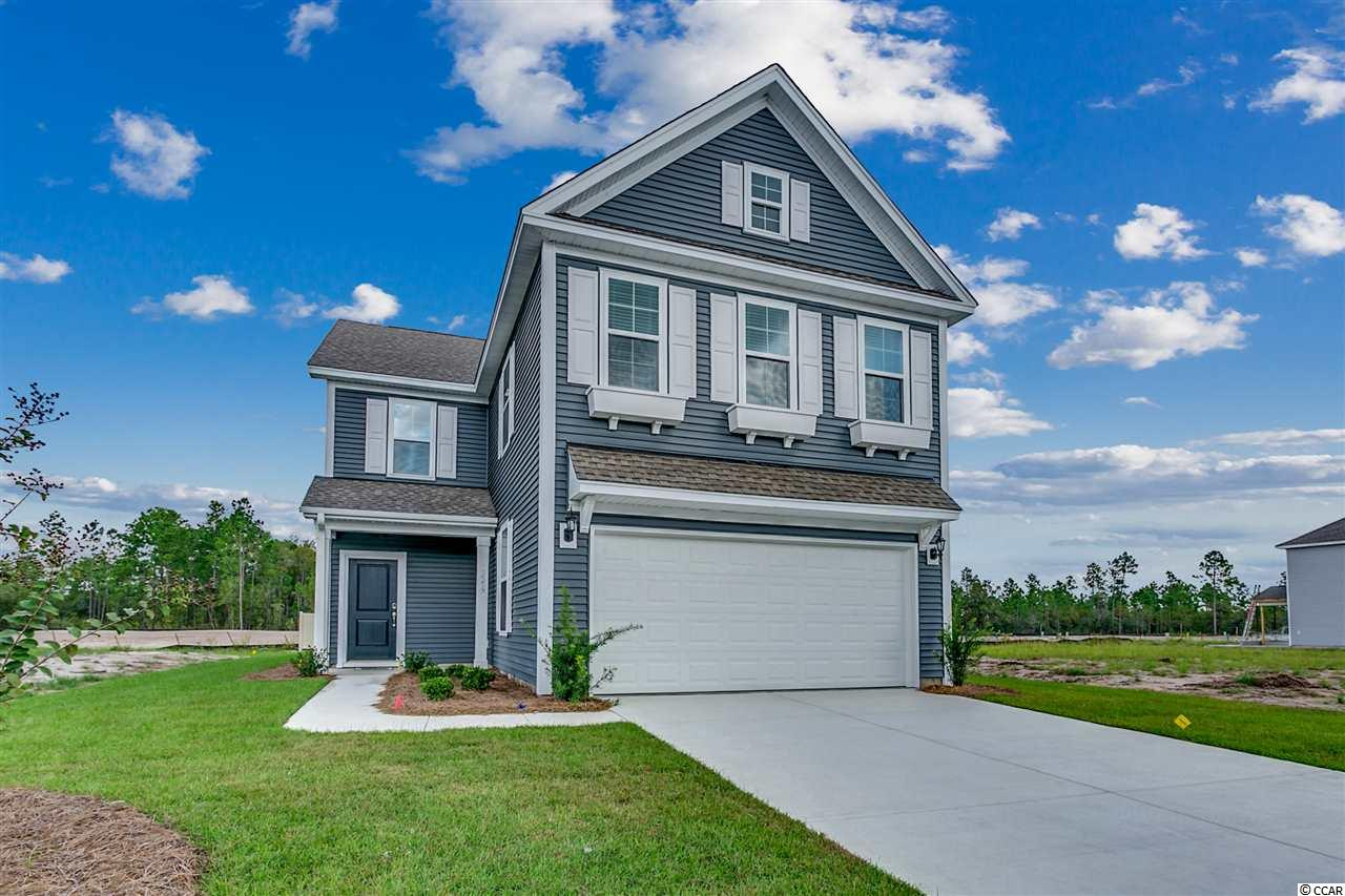 House pictured is representational but not the exact house being built. Walk across your front porch, in to your foyer and WOW, you are in the great room. The powder room and coat closet are placed off the garage for accessible daily use. The kitchen, that is open to the spacious family room has a curved island with a raised bar that will easily seat 5. This home will have a waste-basket cabinet, granite counters, under-cabinet lighting, beautiful grey cabinets and white tile back splash. This home has a pantry in the kitchen and also has an organization space, office or additional storage. Luxury vinyl flooring in the entry, kitchen, eat-in area, gathering area and powder room. The generous dining room is open to the family room adjacent to the kitchen offering a convenient entertainment flow. Upstairs you will find a large master suite with separate closets and dual sinks. There is a loft/gathering area and three bedrooms that will share a hall bath again with two sinks. for convenience, the laundry is located upstairs for easy living.  As with all Mungo Homes, also included: Music port with two speakers and tank-less water heater. All 4 bedrooms and 2 full baths are located upstairs with the loft area perfect for a den or second gathering area. Built HauSmart for energy efficiency and comfort by an Award Winning builder. Clear Pond is a much desired neighborhood convenient to shopping, Conway hospital, restaurants and schools, including Coastal Carolina University, golf and just minutes to the beach and all the Grand Strand has to offer. Clear Pond is a natural gas community. The resort-style amenities offer a clubhouse for gatherings, a large well-equipped exercise facility, a lake with walking trails; playgrounds for children and two pools for swimming, sunning or just relaxing.