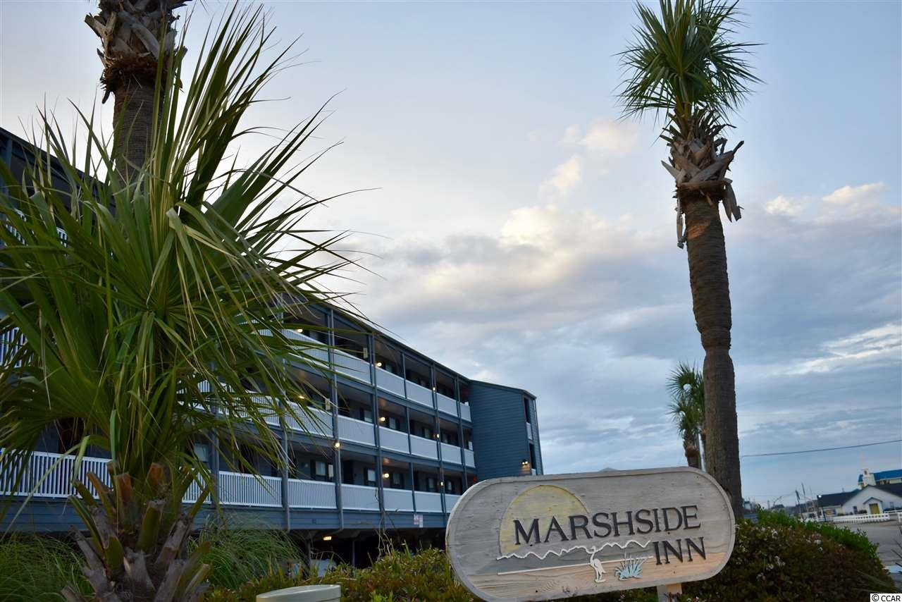 Now this is a Deal! Marshfront and first Floor! Marshside villas is 1 of only 3 complexes on the Marsh/Inlet in Garden City Beach and features one of the largest screen porches of any complex in Garden City Beach! Villa 109 is expertly positioned to capture gorgeous sun sets and a glimpse of the waterfront pool. New LVT flooring in Coastal Gray creates that warm sun soaked feeling that only the beach can provide. Vibrant colors make for a comfortable retreat and efficient kitchen design opens to family room and screen porch. Unit 109 also features a private storage room under building that is ideal for beach chairs, bicycles or even a kayak! Located less than a block to the beach, Marshside offers you the best of both worlds, marshfornt views with pool and hot tub and easy beach strolls by day!