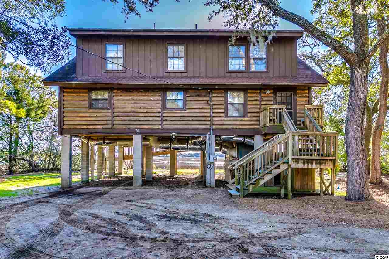 One of the last Creek Front Homes located on the most sought after estate lots in Pawleys Island! Almost 1.5 acres and tons of trees for privacy. Dock for easy access to creek where you can enjoy boating, fishing, kayaking, paddle boarding, and much more! John Boat access to ocean & Brown Pelican Preserve. Relax on screen porch or deck of main home overlooking the beautiful marsh and creek views! 4 Bedrooms and 2 Baths with a separate Den/Study in main home. Cathedral ceiling, heart pine and bamboo wood floors, and fireplace in living room that looks out to creek. Outdoor shower and separate storage area on ground level. Plenty of room for parking, boat storage, or a golf cart which will get you to Pawleys Island Beach in just minutes! 2nd home (structure only) in middle of lot that could be transformed into beautiful guest cottage. And don't forget the amazing restaurants, shopping, golf, and all of the many other attractions of living in Pawleys Island! Call today to grab this amazing property before it gets gone!  Property has the potential to be subdivided and seller is exploring the possibility. More information will be provided as available.