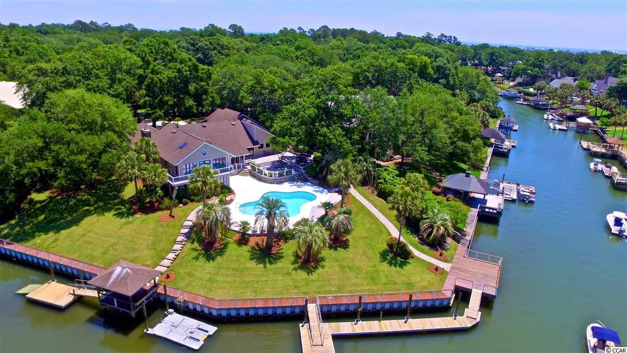 THIS IS A LARGE AND SPECTACULAR CHANNEL FRONT HOME IN THE PRESTIGIOUS AND PRIVATE NEIGHBORHOOD OF MT. GILEAD. THIS LOVELY HOME IS LOCATED ON A DOUBLE LOT WITH OVER TWO-THIRDS ACRE AND FEATURES INCLUDE: A SWIMMING POOL WITH LARGE, MULTI-LEVEL DECKS; STATIONARY AND FLOATING DOCKS; IRRIGATION SYSTEM AND A FENCED YARD WITH AN ELECTRIC GATE. 236 FEET OF CHANNEL FRONT WITH A NEWER SEA WALL AND BRAZILIAN IPE WOOD DECKING. THIS HOME HAS BEEN TOTALLY RENOVATED AND BASICALLY REMADE! PLEASE ASK FOR A LIST OF ALL OF THE RENOVATIONS AND UPGRADES! A FEW ARE: SOLID HICKORY DOORS, AND FLOORING; PINE CEILINGS; ENERGY EFFICIENT SPRAY FOAM INSULATION; CLIMATE CONTROLLED CRAWL SPACE; CENTRAL VACUUM SYSTEM; UPGRADED, HIGH END GOURMET KITCHEN APPLIANCES; NEW GARAGE DOORS AND OPENERS; CAR LIFT; 100% UV PROTECTED WINDOW TINT AND SECURITY FILM ON ALL DOORS NEW WATER HEATER(S), ETC.