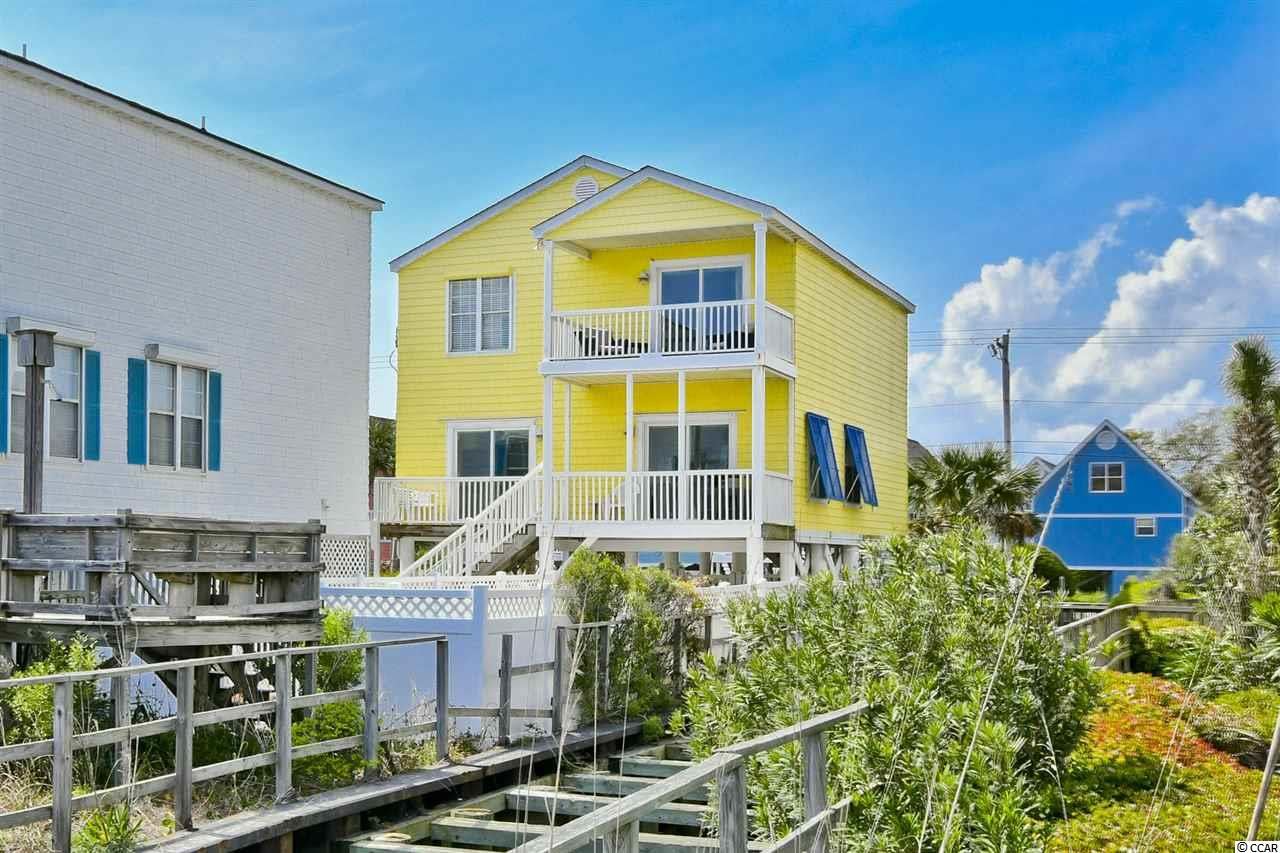 Don't miss your opportunity to own this ocean front piece of paradise located in the heart of Surfside Beach!  It's not very often an ocean front home with these stunning views of the Atlantic in this pristine condition with this many upgrades hits the market.  The open floor plan in the main living area features ceramic tile floors and an upgraded kitchen with granite counters, plenty of cabinet space, and stainless steel appliances including a high end Whirlpool Gold refrigerator.  Each of the four large bedrooms has their own bathroom making this floor plan extra functional.  There is an additional half bathroom that leads to a large laundry room with washer and dryer.  Large balconies off of both floors are the perfect place to relax and enjoy the ocean breeze.  The outdoor area includes an ingroud pool, hot tub, and your very own private walkway to the beach.  The HVAC was replaced in 2018 and new sliding glass doors were installed in early 2019.  This home would make the perfect beach home, primary residence, or vacation rental.