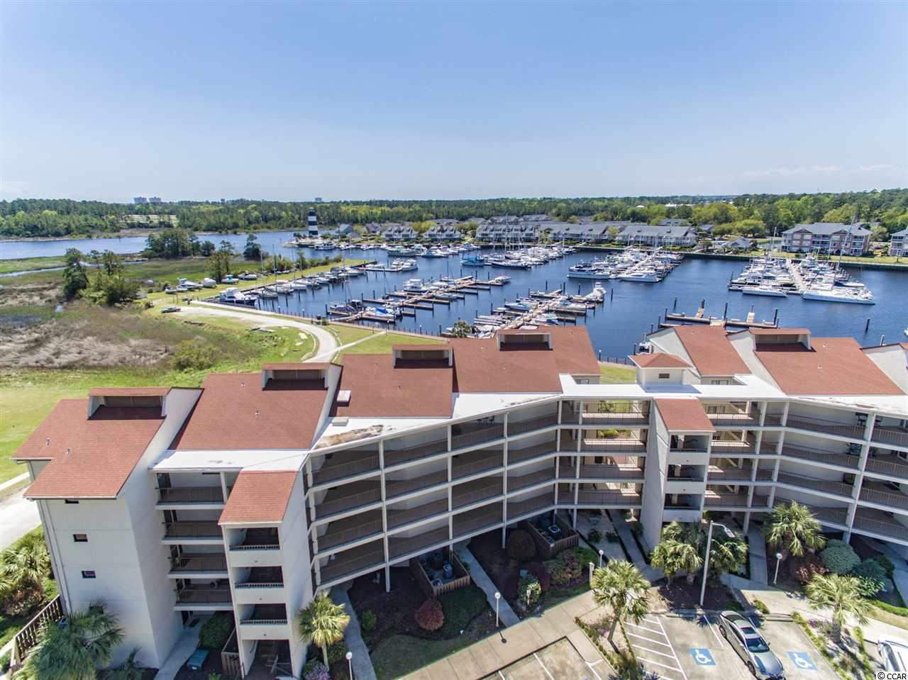 You will be amazed at the water and marina views from your oversized balcony! You may live outside at this one! Not only do you have a huge balcony for entertaining and spectacular views, but you can keep a watch on your boat because this condo comes with a 42 ft. boat slip included in the sale! This spacious 3BR/3BA condo in Little River is calling your name for the perfect water life! Come put your personal touch on this condo with some updating and you will have a rare opportunity to own a unique property that doesn't come available often in this building. Split bedroom plan, views from almost everywhere in the property, and a private and secluded hideaway only minutes to the beach. Don't wait!