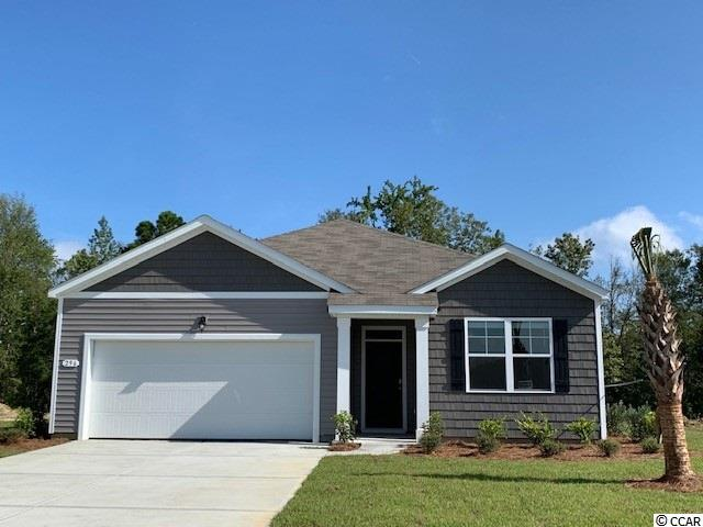 Reflections is a great new NATURAL GAS community in the popular Carolina Forest School District.  Just 20 minutes to the beach or the shopping & restaurants of Carolina Forest/Myrtle Beach.  LOCATION, LOCATION, LOCATION!  CLOSE TO EVERYTHING! IT'S A LIFESTYLE!  This is the Aria plan: our most popular 3 bedroom, 2 bath open ranch.  Wood-look floating floor is a low-maintenance alternative to hardwood, and is located throughout the home, including wet areas (carpet in the bedrooms).  Fabulous pantry, upgraded granite countertops and island with breakfast bar.  Pendant lighting in kitchen.  Stainless Frigidaire kitchen appliances are standard, including refrigerator.  Washer & dryer included as well.  Spacious walk-in master closet.  Covered porch overlooks a private, wooded lot!  Location is fantastic for families & beach lovers.  Jump in the car and you're at the beach in under 20 minutes!  Enjoy life.  Pool & amenity center with workout room included in the cost of the HOA.  This would make a fabulous secondary or primary home. NATURAL GAS COMMUNITY!  **PLEASE NOTE THE PICTURES OF THE INTERIOR ARE OF A SIMILAR HOME IN THE COMMUNITY