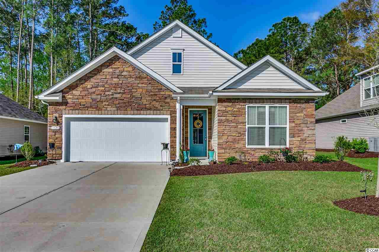 "Beautifully updated 3 bedroom, 2 bath home tucked away in the quiet, gated community of Water's Edge in North Myrtle Beach. This Clifton model features approximately 1796 heated sqft, an attached 2 car garage, and low-maintenance vinyl siding with a stacked stone front elevation. Built in 2017, this owner made many improvements after the purchase: New laminate flooring was installed throughout the house in living areas, kitchen and bedrooms; new ceiling fans with LED lights; all new GE Profile stainless steel appliances; new designer mirrors in bathrooms; new 2"" wood blinds throughout; new light fixture in most areas; new epoxy floor in garage; new garage shelving; new gutters with guards and a lifetime warranty, and new plantation shutter slider at back door. The 18x26 Great Room/ Dining Room combo includes plenty of room for the living and dining area. The open design Kitchen boasts granite countertops with undermount sink, subway tile backsplash, large pantry, new touch sensor faucet, breakfast bar with shiplap wood design and pendant lights, and the new GE Profile stainless appliances: French door refrigerator, double oven range, dishwasher with an extended warranty, and microwave over the stove. Laundry room, just off the Kitchen, has a tile floor, side-by-side washer & dryer, a sink and shelving. All appliances convey! Master Bedroom suite has 2 walk-in closets with custom shelving. In the Master Bathroom, you will find a double sink with comfort height vanities, linen closet, 5' walk-in shower with glass door, tile floor and a water closet. The split bedroom plan has the 2 guest bedrooms on the opposite side of the house as the master bedroom. Home has smooth ceilings throughout. The back screen porch is relaxing and private and has reversible rubber tile flooring. Amenities include the gated subdivision, a large community pool and exercise room. No need to worry about your lawn since the HOA does the mowing for you. The HOA fee covers the gate, road maintenance, pool service, landscape/lawn service, common maintenance & repair, common electric and property management. Trash pickup is through City of North Myrtle Beach's and is billed through water/sewer. Owners are allowed pets, golf carts and motorcycles. Come see this beautifully-maintained property that is just minutes away from the heart of North Myrtle Beach's restaurants, entertainment, shopping and, of course, the Atlantic Ocean."