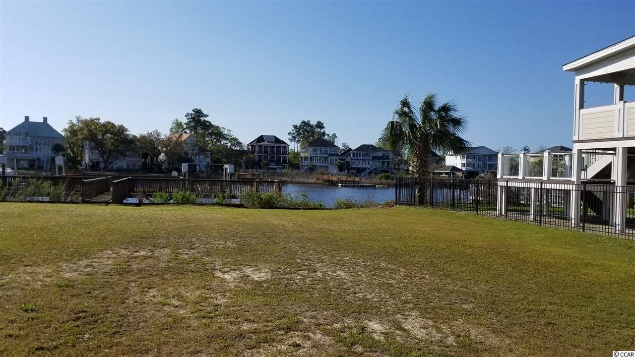 If you want a custom home with stunning INTRACOASTAL WATERWAY views, look no further! Just MINUTES TO THE BEACH, Paradise Island is a gated custom home community close to shopping, dining, the hospital, golf and more! This beautiful home site has been cleared and the boat dock installed. The dock has a large sun deck, hydraulic boat lift and a private floating dock for jet ski's or other small watercraft. Come see why this is the perfect place to build your dream home!
