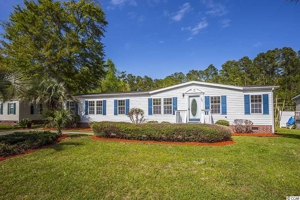 Walk or Golf cart ride to the Beach!! This 3 Bedroom, 2 Bath home has an awesome lake view!!! Beautiful Fireplace & vaulted ceiling in the Living Room, split bedroom plan, Master bath has dual vanities, garden tub and separate shower, new carpet, new counter tops, new paint and many new fixtures plus stainless steel appliances. Large back porch and front porch plus detached storage shed in back. Great LOCATION CLOSE TO BEACH, SHOPPING, DINING!!