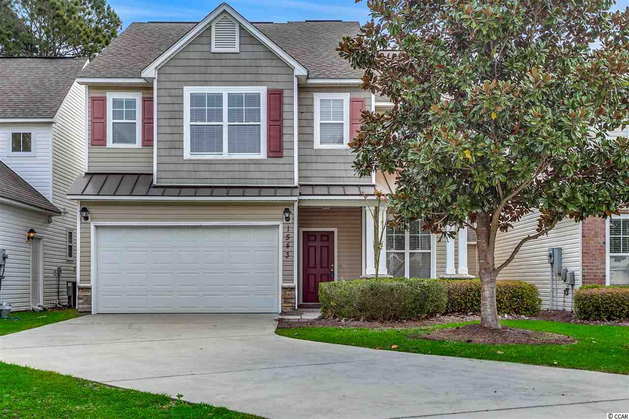"""Enjoy quiet cul-de-sac living in this spacious 3 bedroom 2 1/2 bath home. Overlooking the pond and woods, you will enjoy the close proximity to the beach, shopping, dining and entertainment yet will be just far enough away to have a fabulous neighborhood without the hustle and bustle of tourists! With beach access at Atlantica, you will always have a """"place at the beach and in the sun""""! If you want to be in one of the most sought after school systems in Horry County, check that off your list! This home features formal dining as well as a breakfast nook, a large living area, 1/2 bath downstairs, 2 full baths upstairs, a double garage, new carpet in carpeted areas, and a patio as well as a front porch! Don't miss this opportunity to live in Carolina Forest at a fantastic price!"""