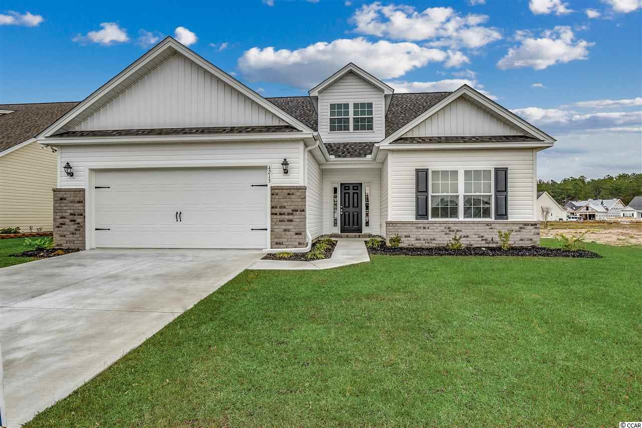 This is our Live Oak II model that is TBB and will be ready approximately the end of August, 2019.  It is located in beautiful Rivertown Row in the heart of Conway, SC.  It features 5 bedrooms and 3 full baths.  The Master Suite is on the main floor with two additional bedrooms.  The 4th and 5th bedrooms are upstairs.  There is a generous bonus area upstairs as well plus a full bath.  It has an open kitchen with a large dining area off of the kitchen.  The great room features beautiful vaulted ceilings and the Master Suite has a gorgeous tray ceiling!  It features upgraded waterproof laminate flooring in the main living area as well.  There is a covered porch in the back that overlooks a beautiful pond.