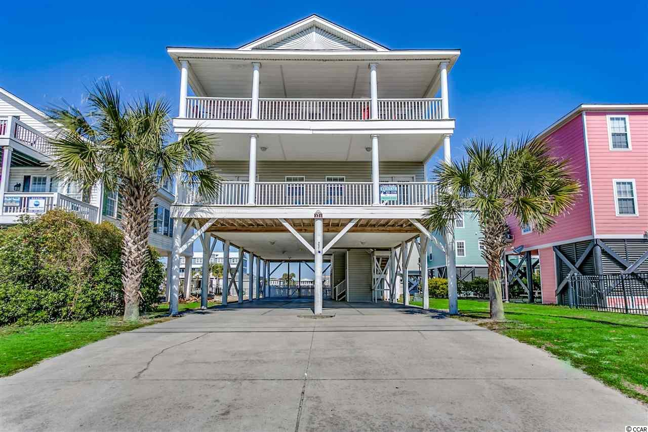 "Great location! Walk across the street and you're on the beach or walk to the Garden City Pier for fishing, ice cream and entertainment.  If you would rather shop, grab a bite to eat or take your children to the arcade and amusement areas, there's no problem. You can find it all on Atlantic Ave. This 7 bedroom, 7.5 bath home's second row location featuring a massive open living area, 4 covered porches running the length of the home, a private heated 12X24 pool and a ground elevator accessible to all levels make this property a strong contender for the discriminating buyer.  As you enter the first level of the property, you will note the inverted floor plan.  A large hallway with wet bar, huge owner's/linen closet and laundry closet housing a full size washer and dryer welcomes you.  To the left, you will find 2 spacious master bedroom suites boasting of ocean views each with French doors opening onto a covered front porch.  Down the hall there is a bedroom with a private bath and at the end of the hall, you will find 2 bedrooms with private baths and private access to a covered rear porch.  Upstairs you will be awed by the home's massive living area with lots of windows providing awesome ocean views and an abundance of natural light.  This living area covers a spacious family room, 2 large dining areas opening onto a covered front porch and a fully equipped kitchen boasting of a large breakfast bar with plenty of seating.  Just off the kitchen, a wide hallway leading to a back porch provides a large pantry, a half bath and opens into a rear bedroom with a private bath and private access to the covered back porch.  A bedroom on the south side of the home offering a private bath with private access to the rear porch completes the floor plan.  The inverted floor plan assures awesome views in the main living areas of the home for all to enjoy!  The covered porches front and back offer ocean breezes, endless views and extended living areas.  Underneath the home, there is an attached storage closet, a picnic area and plenty of room for parking.  The heated pool provides a place to relax in the sun, enjoy your favorite beverage or take a dip anytime of the day. No worries, no family members were  forgotten! The grassy area behind the pool will prove to be a great place for your pets. Considering the property's location and all it has to offer, it is clear that 221 N Waccamaw Dr., ""Awesome Views"" will be a great purchase.  Make it your second home.  A go to place for this summer and the years to come whenever you like or buy it for an investment property and enjoy it when you can. Don't delay. Call me or your Relator to set up an appointment today!"