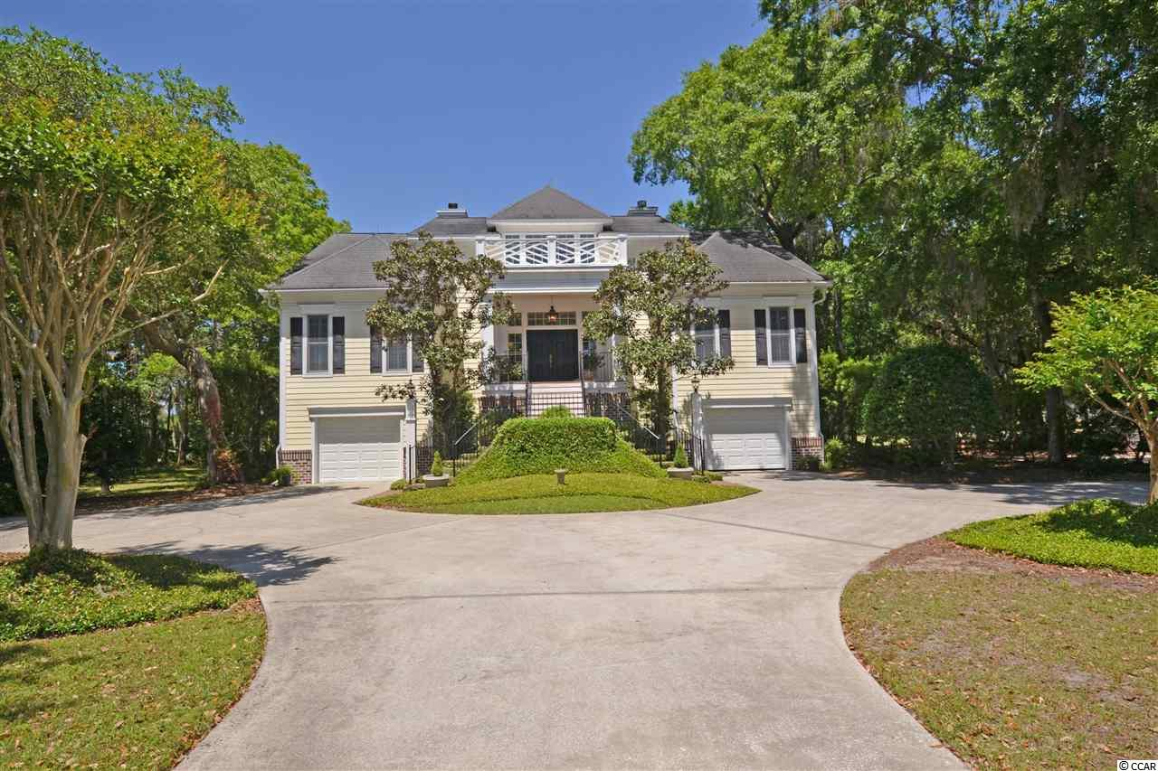 Offering a generous opportunity to enjoy the ultimate in ocean and beach living with golf, tennis, boating, fine dining and much more. Custom home features are extensive molding, 2 fireplaces, hardwood floors, Plantation shutters, separate den and office spaces with a large patio, storage spaces and 2 under home garages.