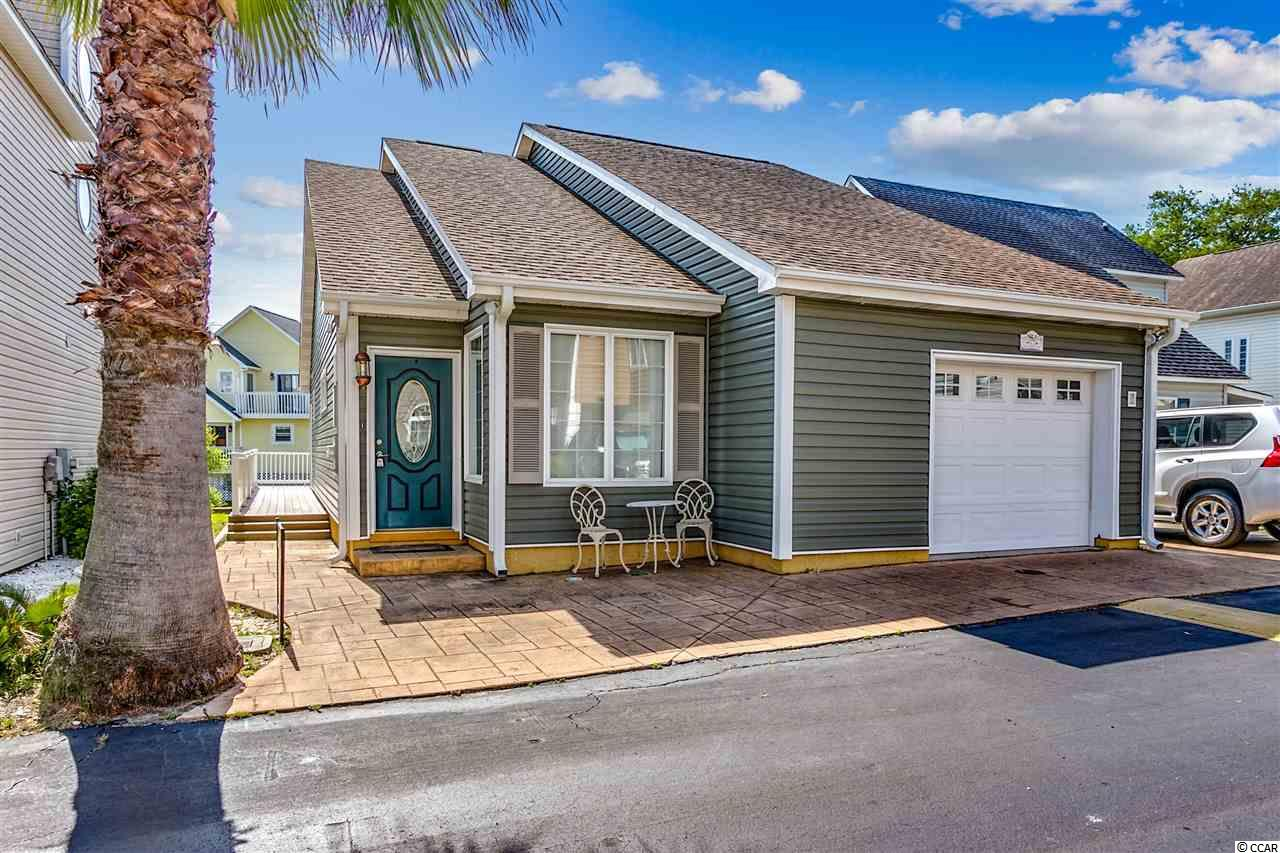 *** OPEN HOUSE THIS SATURDAY APRIL 20th 12-2!!! *** Awesome, one level, Beach Cottage (plus a basement) overlooking the community pool. Located East of Hwy 17 and just a short golf-cart ride (or walk) to the ocean, also near Main St (where there's free concerts every week during the summer), fabulous restaurants and oceanfront bars. This is the best of both worlds~your own private space, with no grass to mow~so, come & go as you please. This fabulous beach cottage is located in the, highly desirable section of Ocean Drive in NMB ~ close to everything North Myrtle Beach has to offer! NMB is famous for its wide beaches! The HOA fees are the lowest in OD and include pool, clubhouse and lawn maintenance making this beach home very low maintenance & turnkey ~beach ready get-away, or primary residence if you choose to turn your vacation into a lifestyle. Comes furnished for immediate enjoyment! Basement area is excellent space to be used as a bonus room, workshop, or storage. Few items to note: Carolina Room and Deck have been added since 2012. Roof is @8-9 yrs old; refrigerator 2015; dishwasher 2015; W/D 2012; siding 2012; HVAC 2016; gutters 2016. Hurry, See TODAY so you don't miss this opportunity!