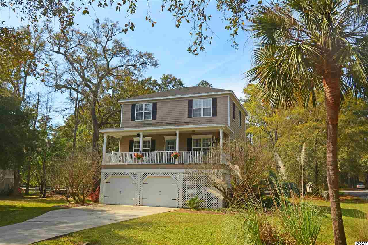 "Fantastic opportunity to live near the beach! This small, quiet neighborhood is centrally located to all Litchfield has to offer - shopping, restaurants, renowned golf courses, and of course beaches! The neighborhood even has a dock, where you can, fish, read, or enjoy a sunrise over the serene and gorgeous salt marshes! This 3 br/2.5 bath raised beach house sits on a large corner lot (invisible fence installed!), with a large front porch and back deck. It has plenty of parking, and even a locked storage unit in the garage. Be sure to click on the virtual tour for a ""real"" walk-thru of the house so you can actually see and feel the layout and flow (just click/tap the circles on floor, also click and drag on walls to turn in any direction)! Whether you are looking for a primary residence or a vacation home, you don't want to miss this opportunity!"