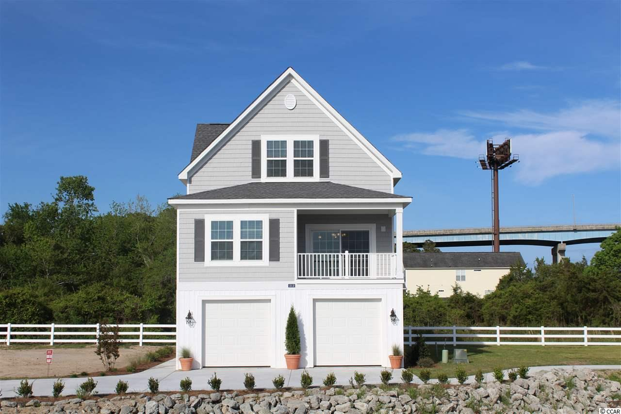 """Special Grand Opening Sale...ask your agent for details about the special incentives. """"Cape Cod Cottages a Water Front Community situated on the Intracoastal Waterway,"""" Ready to move into Your New Home Today! Enjoy the beautiful views of the marsh and the Intracoastal Waterway from your porch. Our quaint community consists of only 32 homes. The Cape Cod style Cottages come in 3 and 4 bedroom floor plans. The Cottages are situated in Little River directly on the Intracoastal Waterway. You will fall in love with open floor plans and the true feel of a New England style neighborhood. Featuring: Open floor plan with lots of windows, 9 foot ceilings on all floors, Ceiling fans, Crown molding in the living-room, dining room & master bedroom, Granite counter tops in the kitchen and bathrooms, Stainless steel kitchen appliances with designer cabinets, Brushed nickel fixtures throughout, Tiled showers along with Comfort height toilets, Upgraded wood flooring in the living areas, Spacious master & guest bedrooms include Jack & Jill style bathroom, Garage doors with opener and parking space for up to 3 cars. Enjoy the day dock with your family and friends, there is plenty of dock space to dock your boat. We have done all the work for you, all you need, is to move in and start enjoying the life style at """"Cape Cod Cottages on the Waterway"""" a prime location to call home. Ask about our builder Incentives! Furnished photos are of the model home."""