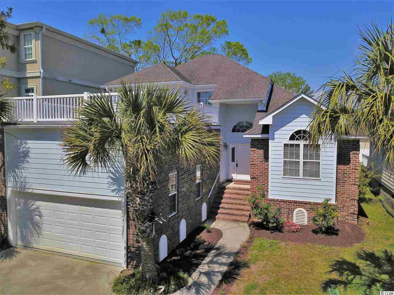 PRIME LOCATION with deep water access, adjacent to the Intracoastal Waterway!  Freshly painted last year as well as new carpet and landscaping!  Start living the waterway lifestyle and keep your boat in your backyard.  Plantation Harbour is a collection of fine homes located in Little River and just minutes from Cherry Grove Beach.  This home features a spacious floor plan with two master bedrooms and an upstairs loft/flex space.   Blonde maple cabinetry can be found in the kitchen with neutral tile flooring, solid surface counter tops, and stainless appliances.  The master baths are equipped with large garden tubs and walk in showers.  Vaulted ceilings and large windows allow plenty of natural light into this beautiful home through the grand living room.  Laminate wood plank flooring in a dark cherry finish complete the living area and main floor.  Want to enjoy the water views...take you living space outdoors with plenty of deck space and balconies to enjoy all of the water views.  Prime location adjacent to Harbourgate Marina and just a few minutes into North Myrtle Beach.  Dedicated homeowner dock and ramp with deep water channel access make this home a desirable place for boat owners or anyone who wants to enjoy the waterway life!