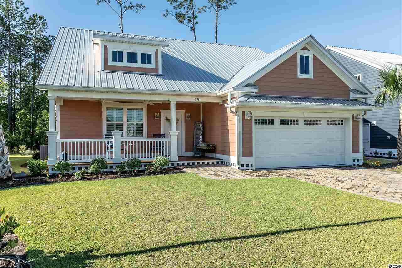 This adorable low country style cottage home in the Prince Creek area of Murrells Inlet offers 4 bedrooms, 3 baths and 2 master suites. Oak Hampton Homes are built with Hardiplank siding, metal roofs and paver driveways. This unique community features homes with custom porches and rocking chairs that give off a feeling a warmness. As you enter the home you will see the craftsmanship throughout the home with luxury vinyl flooring, custom electric fireplace, custom cabinets and granite countertops throughout. This home includes stainless steel appliances with a gas stove, side by side refrigerator and dishwasher, tankless water heater and Plantation shutters throughout. Up the stairway leads to a completed 4th bedroom or media room with a full bath and walk in storage. The master suite is spacious with a large walk in closet, double vanity, full size shower and custom storage cabinet. The Carolina Room invites you to relax and enjoy some downtime, with a paver patio for barbecues. Don't miss the extended garage with custom storage and epoxy floors. This home is absolutely move in ready and gorgeous, schedule your showing today! All information deemed reliable but not guaranteed. Buyer is responsible for all verification.