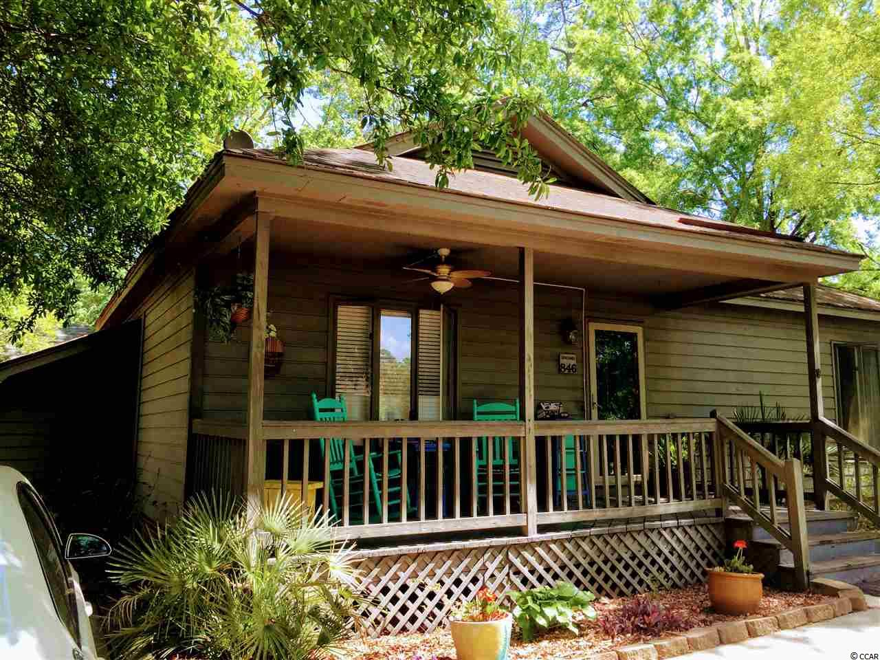 Location, Location, Location!!! This single family 2 bedroom 2 bath home is centrally located in the Garden City/Murrells Inlet community less than 1 mile from the stunning Atlantic Beaches!!! This home is awaiting its new owner who can envision the updated and finished beauty! Some of the updates have been started including the kitchen featuring beautiful granite counter tops. Solid bones, hardwood floors and one of the few homes with a detached garage! Situated on a quiet tree lined street with lovely porch and a Patio in rear of home. TIME to enjoy the outdoors! Separate Mudd room & Laundry room. Low HOA fees includes a clubhouse and an outdoor pool WITH wonderful community interaction!. Location, Location, Location!!! This home is loaded with potential and is nestled close to the Kingfisher Pier for the Fishing enthusiasts, nearby multiple Golf Courses for the avid Golfer in the family, and within walking distance to shopping and Restaurants for the fun-and Retirement or Vacationing!!!... Picture yourself on you golf cart for a short ride to the Beach... lots to love!!! Contact your agent today for a private showing or listing agent.