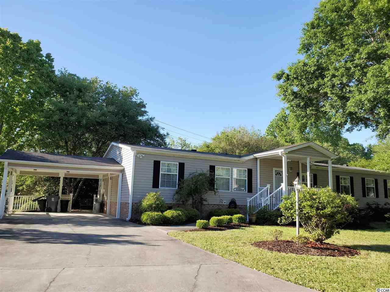 Lots of extras in this Home. Completely rewired throughout, 4th bedroom was made into storage room.Gas fireplace.Detached shed with electricity and AC.Private backyard.12x24 deck, 11x7 Foyer, 9x9 laundry room.Lot rent includes garbage & trash pick-up.Close to Waccamaw Hospital, Intracoastal Waterway, Murrells Inlet Marshwalk, Brookgreen Gardens, Shopping, Restaurants and the Ocean.