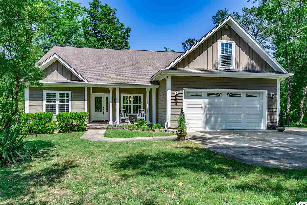 Check out the great pictures of this rare find! Ready to move right in and easy to show! This lovely custom built home is located just 7 miles from the hub of Myrtle Beach. The size of this 3400+ heated square foot home is deceiving from the street. The home is beautifully set on a 1.5 acre estate lot with beautiful moss-draped hardwood trees. Open living plan, ideal for entertaining or wonderful for a growing family. Custom kitchen opens to the family and dining areas. Beautiful hardwood floors throughout!  Home was custom designed to maximize natural light and each room is thermostatically controlled – large windows throughout the house, floor to ceiling windows and French doors leading to a Large screen porch which overlooks a beautiful private fenced in backyard – a natural preserve behind the home. This is a 4 bedroom home, Large rooms, 2 downstairs and 2 upstairs with 3.5 baths, all of the bedrooms are separated nicely for privacy. A Large Master is on the first floor with a second Large suite on the second floor. Master on the first floor has an Amazing Custom Shower – A Must See! In addition to all the custom features of this home there is also a Large Bonus Room and Office too. Large closet spaces in each of the 4 bedrooms. Additional closets throughout - Storage is not an issue in this home. Another great feature is the over-sized two car garage with an extended bay large enough to use as a workshop or house motorcycles, golf cart and/or riding mower. Wood shelving galore in the garage. Home has a Conway address, but is just a mile from the new International Drive that connects this peaceful tree-laden neighborhood to the busy center of Myrtle Beach – convenient to the airport, beaches, shopping, entertainment venues and medical facilities. Sellers are motivated! Make an appointment today to see this gem! Note: All measurements are approximate and should be verified by the buyer.