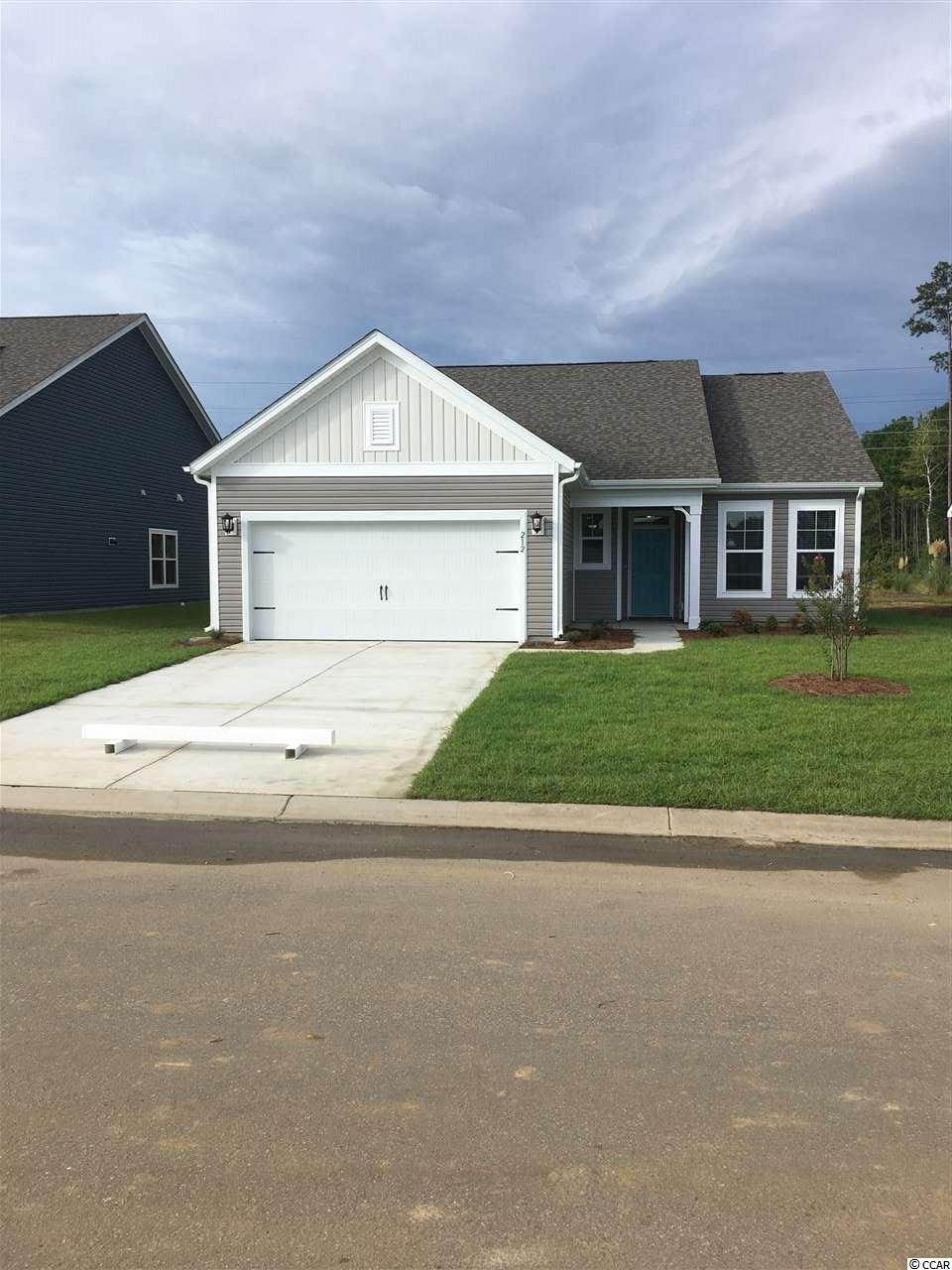 Welcome to Surfside Plantation, a charming coastal Beazer Homes community with Natural Gas and is located 3 miles to the beach. This home is the Camden plan and is under construction with an estimated August completion. 3 BD, 2 BA, 2-car garage home on 1 level. Vaulted ceilings, bay window, are rear covered porch are included. Vinyl plank flooring in the main living spaces, ceramic tile in bathrooms and laundry, quartz countertops, white cabinetry, tile backsplash, and pendant lighting over the island. The kitchen is massive and is a must see! The master bathroom features a double vanity, walk-in closet, linen storage, and a 5' tile shower. Home is equipped with a stainless gas range, dishwasher, microwave, fridge, washer, dryer, ceiling fans, blinds, and gutters. Nickel faucets and lighting throughout. Home is being built on a wooded-view homesite with a fully sodded yard and professional landscape package. *Pictures shown are from previously built homes. Listing details are subject to change. Please consult the on-site New Home Counselor for all details.