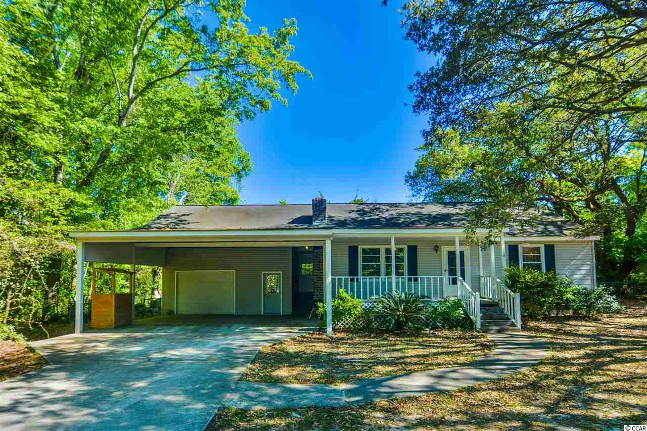 3 beds and 1.5 bath on double fenced lot. Huge garage and workshop with carport as well. Lots of storage , fireplace, pull down attic, front and rear porches. Needs a little TLC, but what a great price and location. Minutes to historic Georgetown, shops, restaurants and marina.