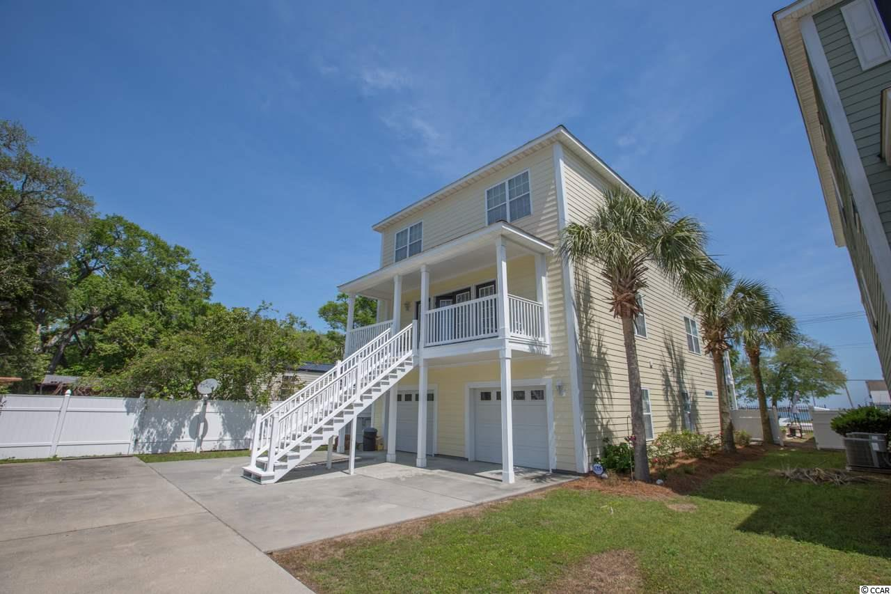 Looking for a home with beautiful sunrises and Inlet views all the way to the point? Like to fish? Would like to swim in your own private saltwater pool with no HOA fees? Bring your bag, swimsuit and your boat this is it!        You are going to Love this furnished 7 bedroom, 4.5 bath home in the heart of Murrells Inlet. The 1st level offers a large 2 car garage with extra storage space, bedroom with a full bath, easy care wood look flooring, kitchen cabinetry, sink and refrigerator. Step out to your pool and take a dip from here! 2nd level features hardwood flooring, large open family room, formal dining area for those big family get togethers, eat in kitchen including all appliances, breakfast bar and nook. 1/2 bath, 10 x 6 office nook & enclosed porch overlooking the pool. 3rd level includes 6 additional bedrooms and 3 full baths plus deck access with inlet views from 2 of the bedrooms. Crown molding, ceiling fans, irrigation, security system, fencing, painted exterior 2018. Enjoy Huntington Beach oceanfront State Park or Brookgreen Gardens that are just 2.5 miles away or ride your bike along the Murrells Inlet bike trail. Great dining within walking distance including Hot Fish Club, Nances & Russells or take your golf cart to the Murrells Inlet Marshwalk to enjoy more great food, entertainment & spectacular views! Call today to schedule an appointment to see your next home! Square footage is approximate and not guaranteed. Buyer is responsible for verification.