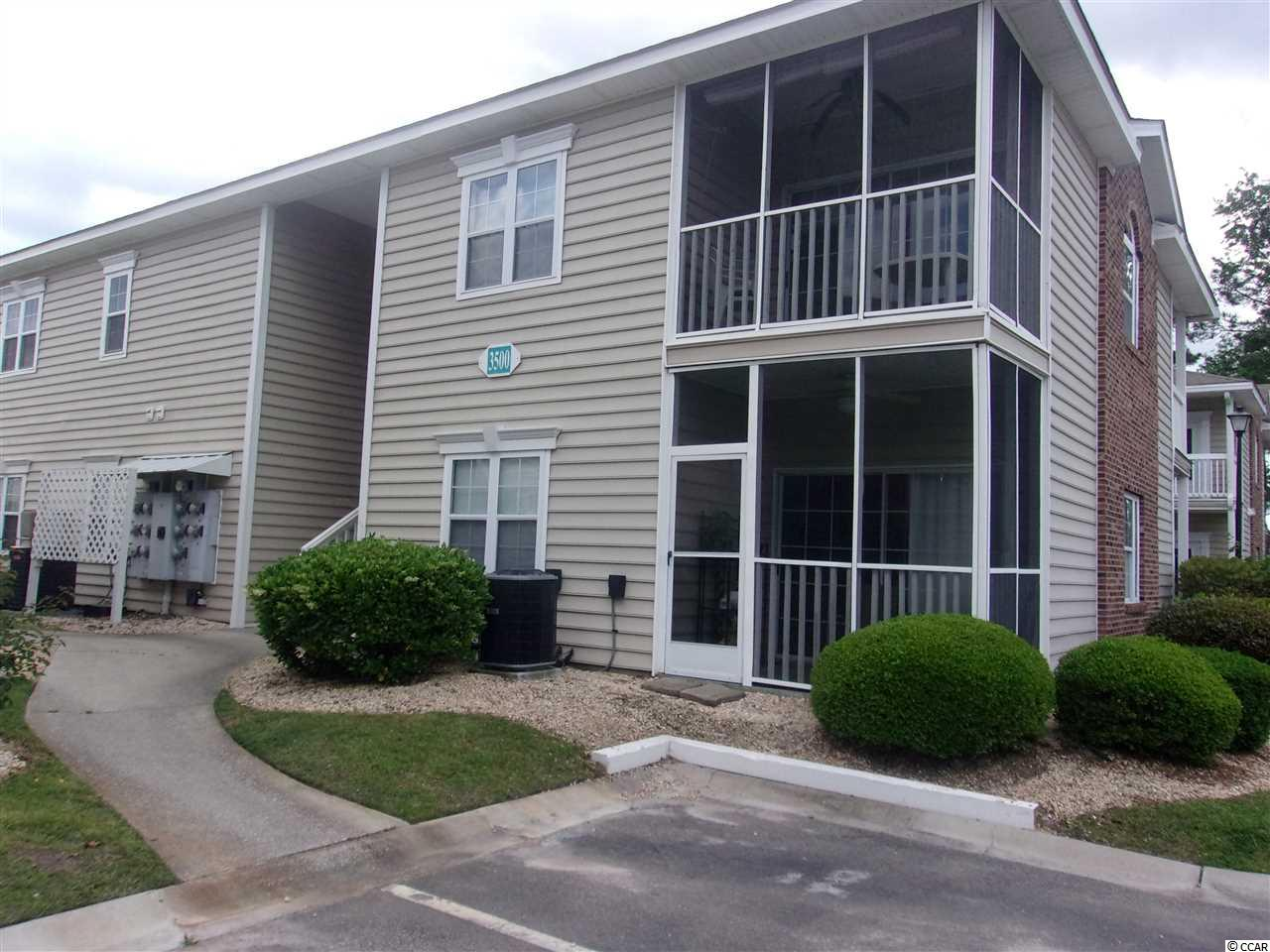 Adorable first floor condo in desirable Sweetwater subdivision. Features include 2 bedrooms and 2 full baths, large living area, kitchen with lots of cabinet space, laminate hardwood floors in living area and tile in baths and kitchen. Second bedroom with Murphy Bed. Very roomy when pulled up. Bedrooms have carpet. HVAC system approximately 5 years old. Original owners enclosed screened porch, now a heated and cooled sun room. Storage closet on porch, plenty of storage space throughout. Great location close to beach, restaurants, shopping and golf. See today!!