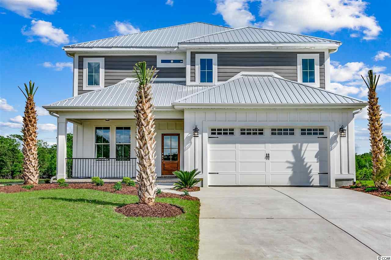 """NEW CONSTRUCTION HOME ON THE ICW! This attractive Low Country designed Home with modern touches is truly a must see. This beautiful home features board and batten & fiber cement siding, a metal roof, stained wood ceilings on both front and back porches, a stained wood front entry door, high end garage door, upgraded lighting fixtures, and LARGE Back yard with sprinkler system.  The interior of this home features a """"low country modern feel"""" including Formal dining room, White quartz countertops in kitchen, shaker cabinets, stainless kitchen appliances, engineered hardwood flooring, double tray ceilings in the master bedroom, the master bathroom has a massive walk-in tile shower, soaking tub, double sink vanity and make up vanity with Large walk in closet!! The property also features tankless hot water heater, outdoor kitchen area,breathtaking views of the ICW, and so much more.. Gated Community..   SC Realtor/ Owners"""