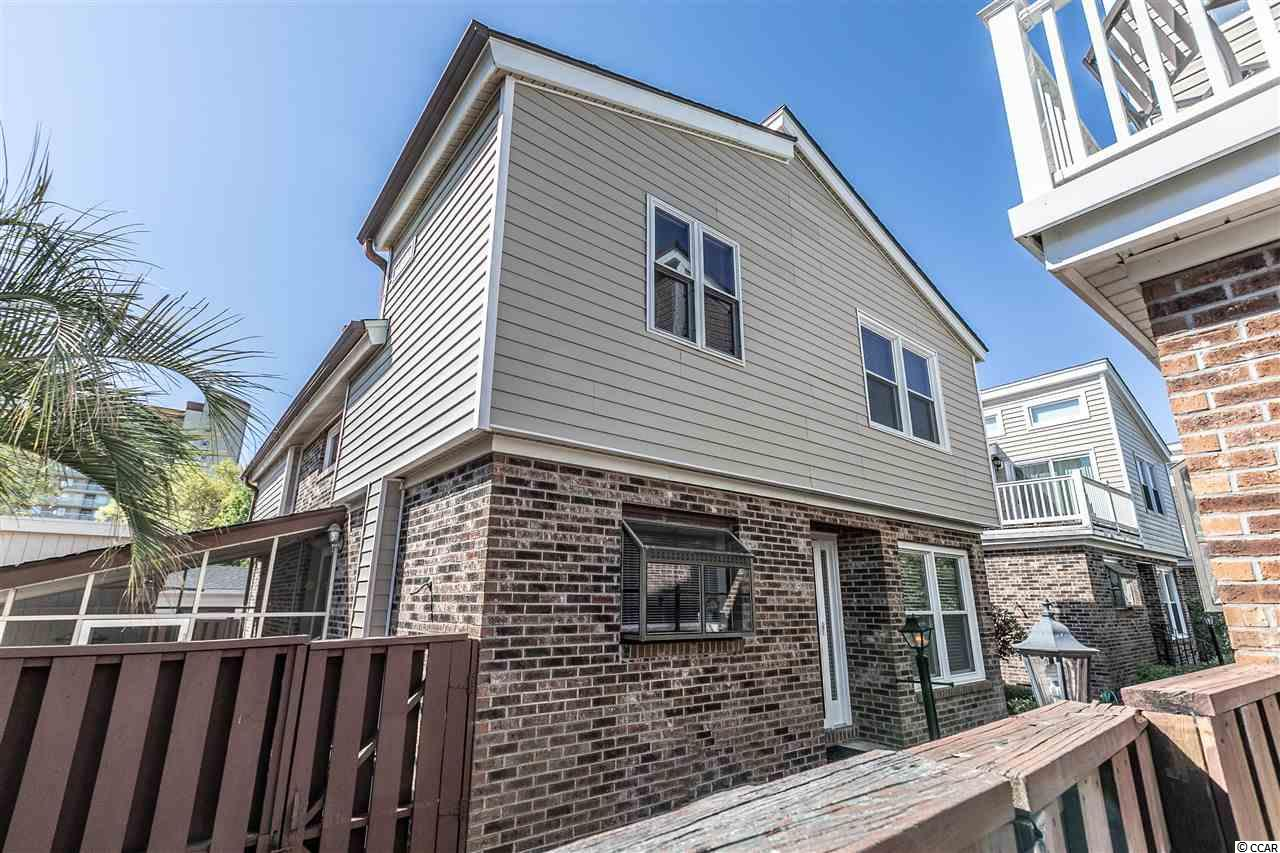 **Open House 6/22, 12-2pm** This immaculate 3 bedroom 3 bath patio home is move in ready and ONLY 1 1/2 BLOCKS FROM THE BEACH! NO HOA! The location is very private, with a large screened-in back porch and fencing. This is the largest home in the complex and the only one with 3 full baths. Other features of the home include skylights that let in plenty of natural light, brick fireplace in the living room, back patio area for grilling and entertaining, and workshop/storage building. Amazing location with a short walk to the beach and close to everything North Myrtle Beach has to offer. Recently updated with new carpet and paint. Schedule your showing today! All information deemed reliable but not guaranteed. Buyer is responsible for all verification.
