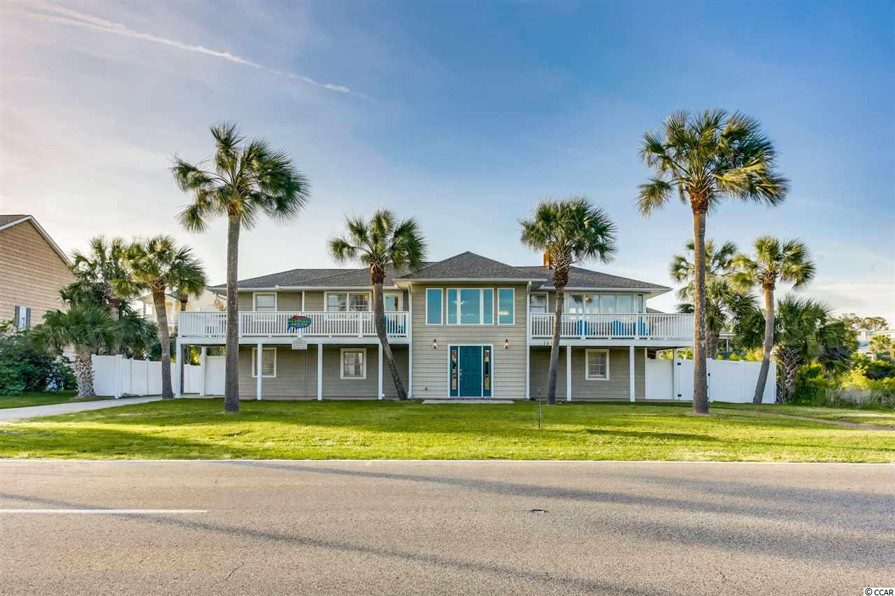 Key West House 6BR/4BA 2nd row Beach Home. Just steps to the beach.  This home was remodeled & upgraded in 2017 and the bathrooms were update in 2019!.  Stainless appliances, new cabinets, granite counter tops, flooring, decks & more!  Enjoy swimming in the outdoor pool, new bullfrog hot tub, shuffle board, basketball, etc.  New HVAC installed in Sept 2017.  This home is located in the Tilghman Beach section of North Myrtle Beach!