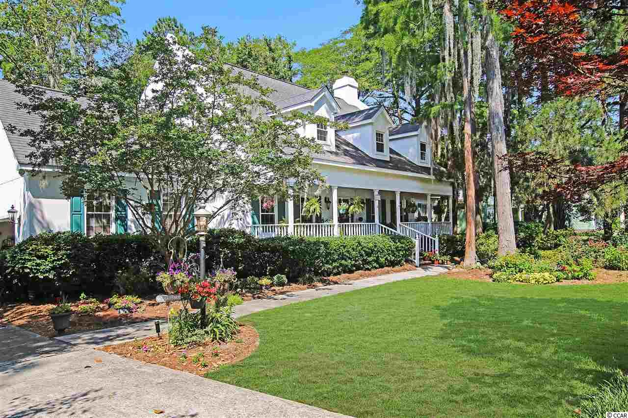 """Presenting this glamorous """"Southern Living"""" 3 bedroom 2½ bath home located in the Burning Ridge community. An inviting front porch starts you off as you make your way into the sunlit living room with a wood burning fireplace and French doors that open up to the relaxing Carolina room. You notice the character of the hardwood flooring along with the crown moulding and the formal dining room with chair railing. The spacious kitchen comes with custom oak cabinets, breakfast bar, smooth flat top cooking area, wall oven, built-in microwave, and a breakfast nook. The first floor master suite has his & her closets with a master bath that includes vanity with dual sinks, jetted tub, and a step-in shower. Up stairs you will find a den with a palladium window and two large bedrooms which are joined together with a Jack & Jill bath. This distinctive home comes complete with mature landscaping, a security system, irrigation system and a two car attached garage. This home is on a beautiful tree lined street with only 33 homes and provides you close proximity to all the attractions and amenities of Myrtle Beach, with fine dining, wonderful world-class entertainment, fishing piers, exciting shopping experiences on the Grand Strand, Conway's antique shops, and the River Walk. Just a short drive to medical centers, doctors' offices, pharmacies, banks, post offices, and grocery stores. Check out our state of the art 4-D Virtual Tour."""