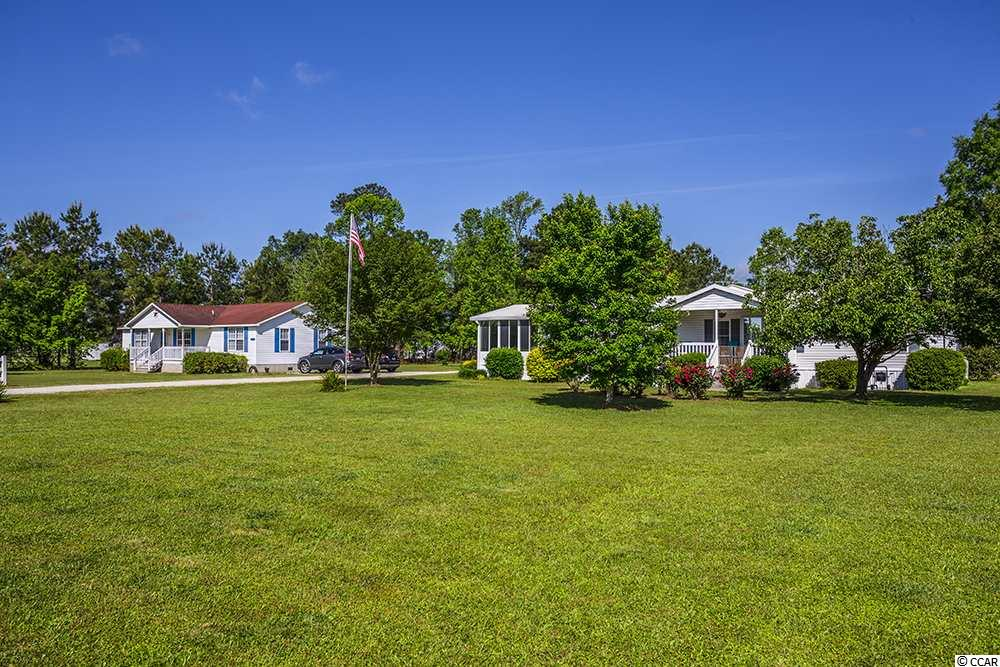 Two Homes! Situated on two parcels 2410 and 2418 both totaling 8.46 acres.  2410 Troutman Circle is a 1996 Manufactured home that has been totally updated and upgraded, nice and open floorplan, crown molding throughout, 3 Bedrooms, 2 Baths,  split bedroom plan, Livingroom with a propane fireplace, vaulted ceilings and leads out to a 12 x 20 Carolina Room which overlooks large backyard with gazebo with electricity and also views of the horse barn. Formal Dining Room. Spacious kitchen with newer appliances and breakfast nook that leads out into another large 12x24 Carolina Room.  Master bath has a large walk-in shower and linen closet.   For the horse lover/owner, property offers a 6-stall barn with feed area and additional tack rooms with space for another stall and an 10x12 outdoor wash stall. Work shop, 2 extra storage buildings, mini horse stall, 3 fenced in Pastures and a training pen.  Storage building for equipment.  There is a location with separate Water, electric and septic for an RV or trailer.  So much to offer, must be seen. Second home at 2418 Troutman is a 1995 Modular home that is 3 Bedrooms, 2 Baths and an open floor plan also. Front and rear porches for more enjoyment.  So many options with the property, could use 2nd home as mother/father in law home, rental or separate properties (both sides already have their own Pin numbers).
