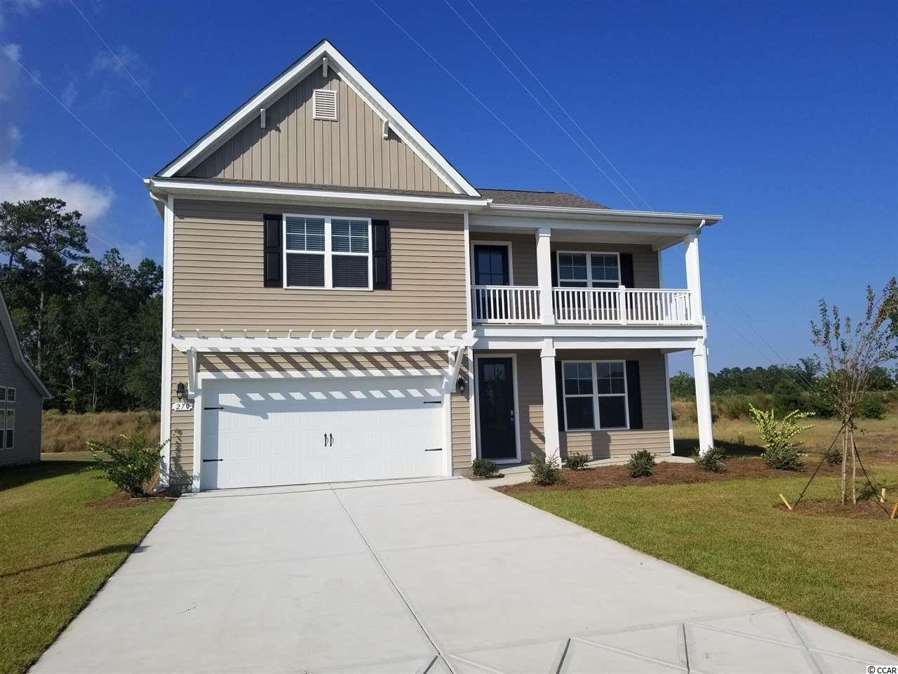 """Inlet Reserve is the place you want to call home! This is a natural gas community featuring 69 spacious homesites with private and pond views, conveniently tucked away in the heart of Murrells Inlet , yet just a short drive to championship golf courses, marinas, shopping, hospitals, beaches and the Marsh Walk where you'll find year round entertainment and award winning restaurants with spectacular views of the salt marsh and wild life.  If you are looking to downsize, upsize, or to add a pool and create your own outdoor living space, Inlet Reserve has the homesite and home for you.  We offer a mix of 1 story and 2 story thoughtfully designed open living floor plans, perfect for entertaining family and friends. The Tillman E is a Beautiful 2 story home featuring double front covered porches, 5 bedrooms, 3.5 bathrooms, crown molding, tray ceiling, 5 1/4"""" baseboard and trimmed out windows, 8ft. entry door and huge loft. This home offers a formal dining room that flows through to a spacious kitchen with 36"""" staggered height cabinets , granite countertops which includes a large gourmet island overlooking the family room, pantry, glass tile back splash, pendant lights and stainless steel appliances. 1st level features a an open floor plan with wood floors throughout the main living area. Off the living room 8ft. sliding doors lead to a rear screened covered porch with private view! Owners suite and bath offers a walk-in closet, 5 ft. walk-in tile, double vanities and bowls. Oak treads and painted risers take you to the 2nd level family room, 4 large bedrooms, 2 additional baths and laundry room. Tasteful interior touches run throughout the house to finish off this must see home. New Community in popular St. James school district. Pictures are of a previous built home and are for representation purposes only.  Call and schedule your appointment today!"""