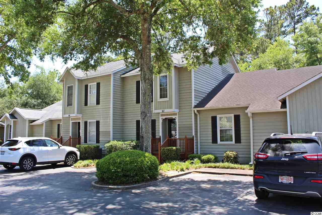 Conveniently located near Murrells Inlet Restaurant Row, the Marsh Walk, and just a few minutes to Garden City Beach. This condo overlooks a pond in back from the 1st floor deck and 2nd floor balcony. It has 2 master bedrooms, new HVAC 2018, new carpet on the 1st floor, stainless steel appliances in the kitchen, large living room, community pool and tennis right across the street. Close to everything the area has to offer. Needs some TLC. CLICK THE VIRTUAL TOUR LINK FOR: FLOOR PLANS, HD VIDEO, PICTURE GALLERY, INTERACTIVE MAP, AREA ATTRACTIONS AND MORE.