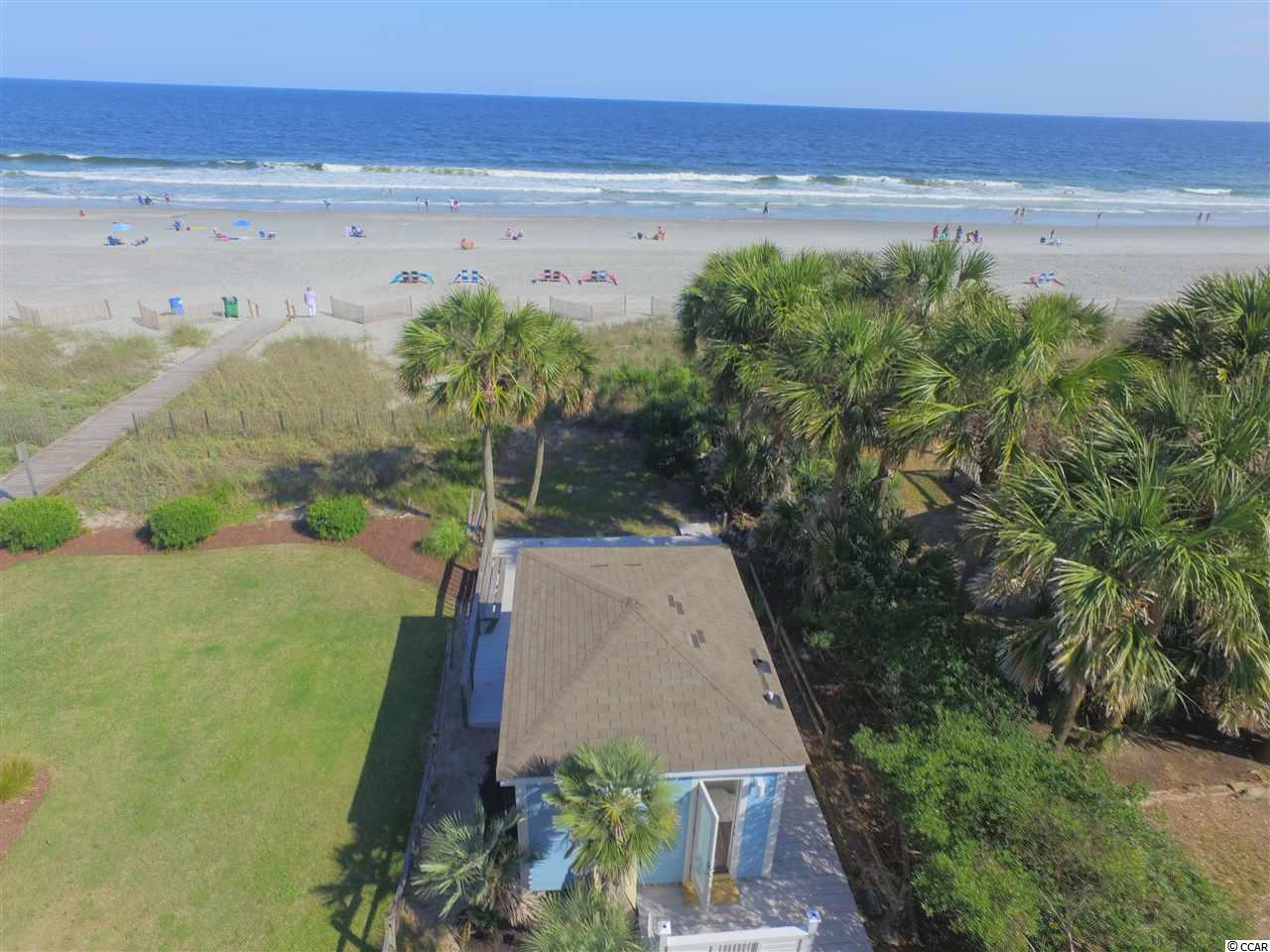 This remodeled day cabana is truly your piece of paradise located on the oceanfront.  What makes this so special is the prime location and the rarity of this highly sought after gem on the pristine white sands of  Myrtle Beach.  Your diamond on the beach has been renovated inside and out in a cool Coastal theme.  Enjoy the large deck, yard for sunning and games, convenience of a restroom, air conditioning, dish sink or wet bar, full size refrigerator, beach accessory storage, daybed, shower and amazing views and sea breezes from this oceanfront property while you enjoy the beach.  The exterior is durable concrete fiber cement siding.  The location is central to all the fun of the Grand Strand including shopping, dining, golf and attractions.  Don't miss out on this special opportunity.