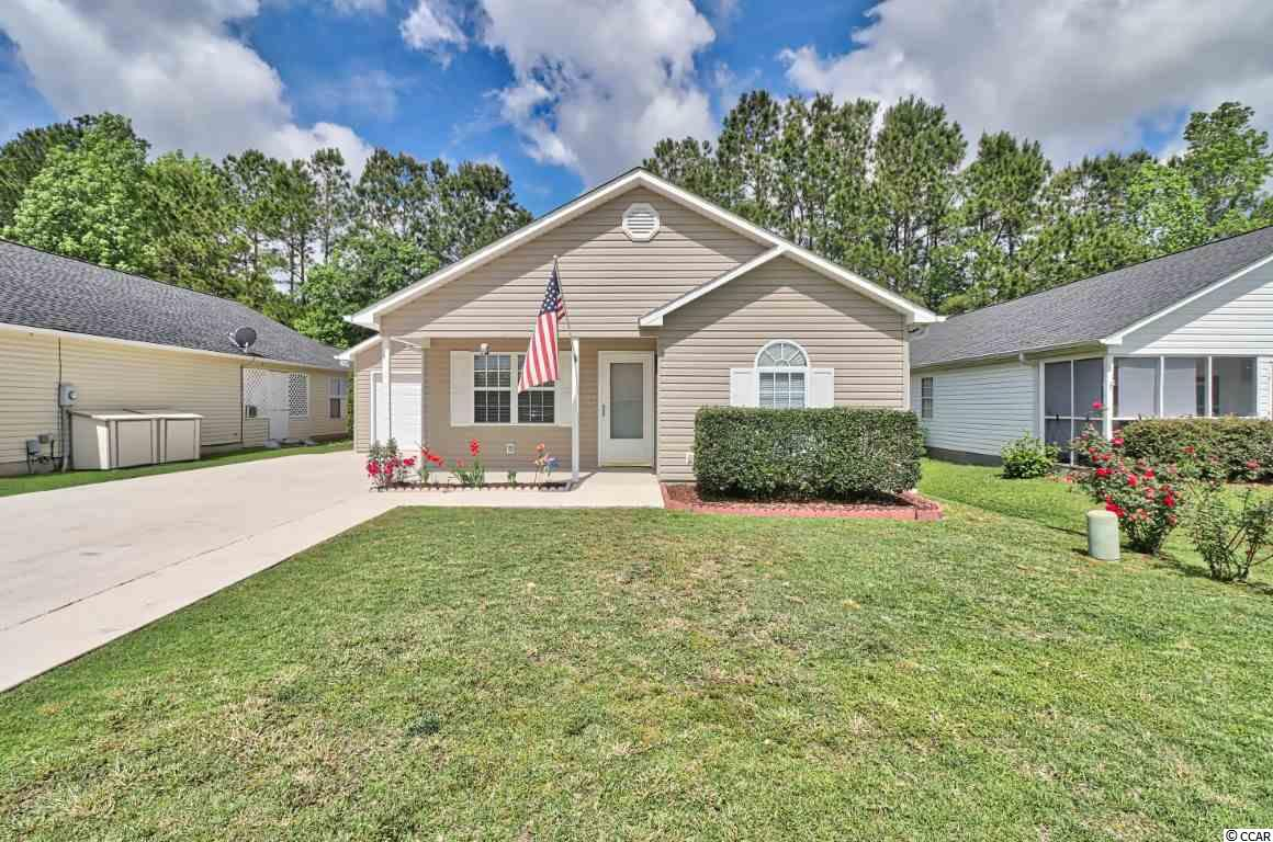 "Come check out this home that has so many upgrades you won't be disappointed! This 3 bedroom 2 bath home in the St. James school district has been lovingly maintained by its owners and it shows. Beautiful flooring as you enter that runs through to the kitchen and dining room. Spotless kitchen that leads to the dining room. There is a wood pellet stove that can heat up the home with clean efficiency. Leading off the dining room is the ""Man cave"" that leads out to the back yard paradise! Take a look at the pics and you will see why! There is a newly installed hot tub, an inground pool and a pool bar! There is 8 foot fencing for privacy, you will not want to leave it's so peaceful! The attic is floored with easy access in the finished garage. There is also an outside storage area in the back and lawn irrigation. The interior of the home has all LED lighting along with a video DVR surveillance system. There is also a built in generator system for peace of mind. The home is centrally located in Murrells Inlet and close to shopping and restaurants. Come check it out soon before it's gone! Square footage is approximate and not guaranteed. Buyer is responsible for verification."