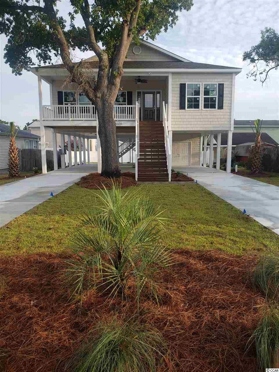 4BR / 3BA new raised beach style home east of Hwy 17 in NMB.  Home features 9 & 10' ceilings, crown molding, custom kitchen with granite and stainless appliances. Master suite with double vanity and full tile shower. Ceiling fans and wood floors throughout. Fully landscaped yard with concrete driveway.