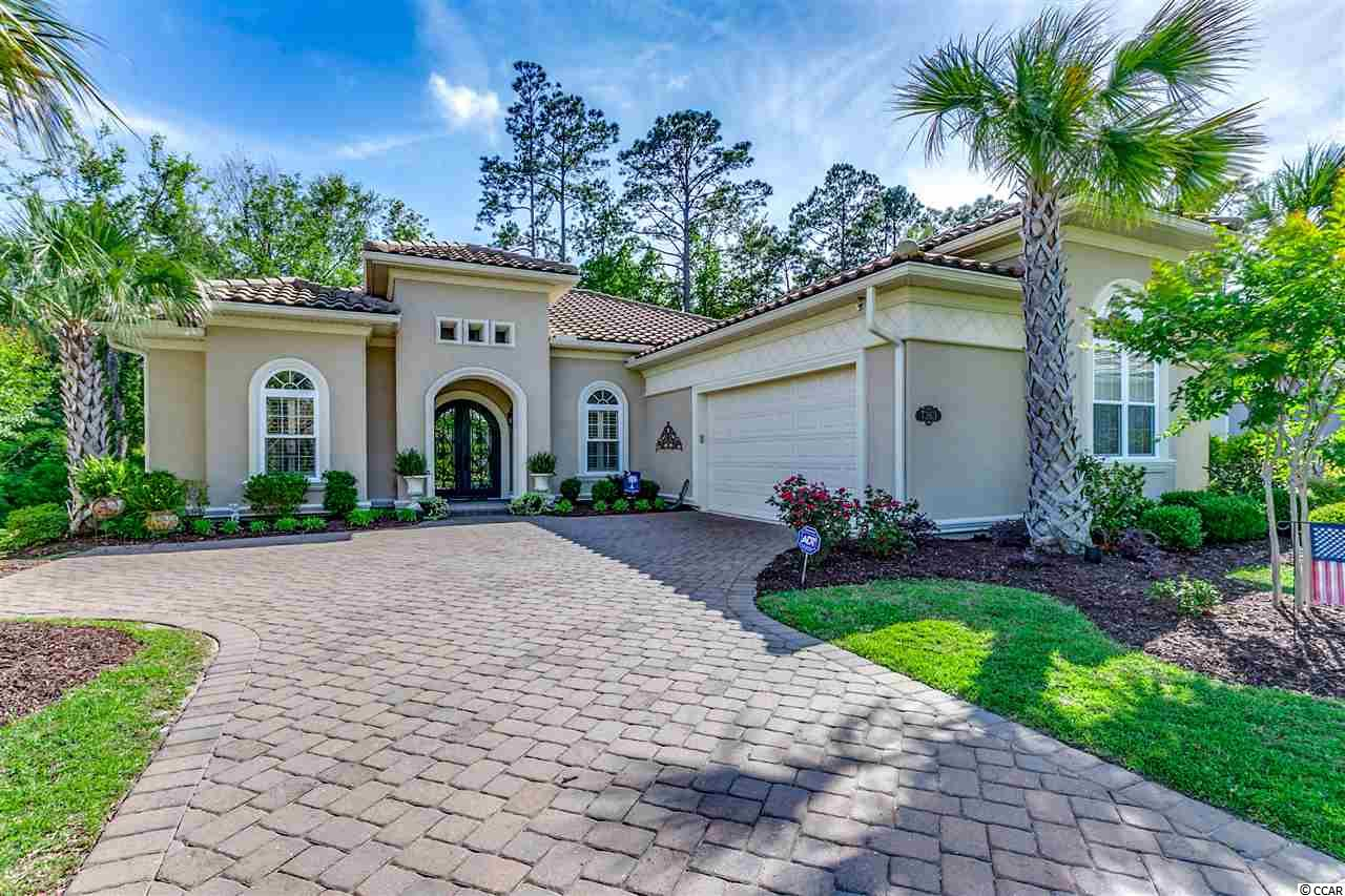 Your perfect upscale beach home is just the right size, not to big and not to small. This gorgeous custom built home has everything you could ask for and more. You will fall in love with this gated upscale community that allows you to walk or ride your golf cart to the beach. Some of the details this luxurious home offers are as follows, massive Iron front door, 8ft doors through entire home, multiple trey ceilings with rope lighting throughout, crown molding throughout, gas fireplace, granite countertops throughout, commercial grade Viking gas stove/oven, upgraded appliances, deep kitchen pantry, plantation shutters throughout, custom closets with built-ins, raised pedestal for washer and dryer, separate wet sink in laundry room, oversized garage with built in cabinets and much more. The outside of the home has a beautiful screened in porch with a automatic screen that raises and lowers, custom outdoor BBQ with a Viking grill, refrigerator and beautiful outdoor fountain that is remotely operated. This is the most exclusive community in Myrtle Beach, The Grande Dunes. The Grande Dunes offers a massive oceanfront Club House (Ocean Club) with multiple pools, locker rooms, towels, restaurant, bar, poolside bar and waitstaff as well as complimentary umbrellas and chairs on the ocean. The Grande dunes also offers a secondary members club on the private course and has a secondary public course as well as a Marina, Tennis club and much more. This home is aggressively priced and won't last long! Schedule your appointment immediately.
