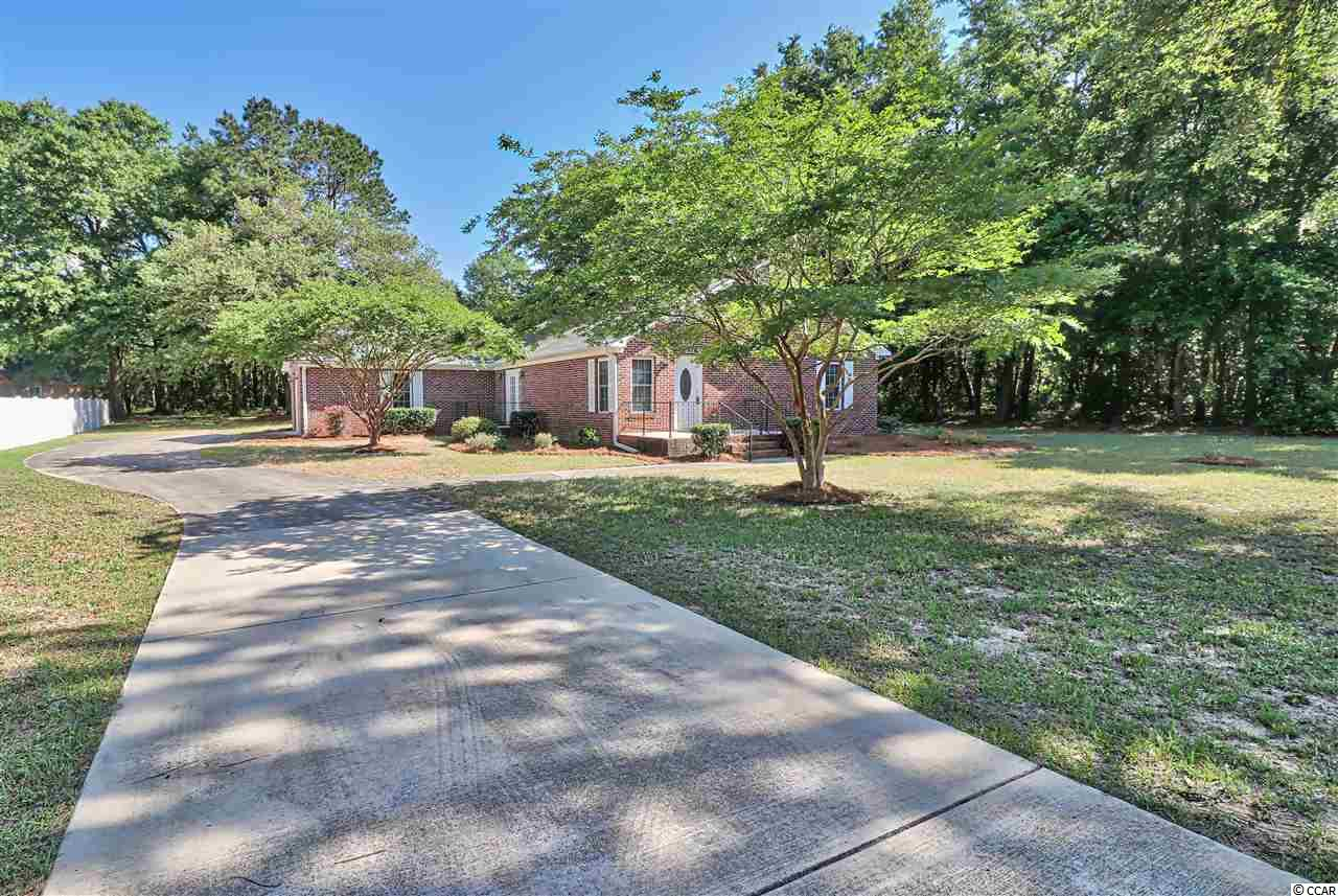 All brick single level home in Pawleys Island located on huge .69 acre lot with plenty of room for Boat/RV parking. RV electric/AC hookup in place. No HOA fees. Cozy 3BR/2.5BA ranch with vaulted ceiling in living room, kitchen with breakfast bar. Large master bedroom with walk in closet. Two additional guest bedrooms. Garage is heated and cooled. Home warranty. Oversized detached workshop out back. Short five minute drive to the beach. Convenient to quaint shopping, fine dining, world class golf and leisure activities. Ideally located 30 miles south of Myrtle Beach and 60 miles north of Historic Charleston.