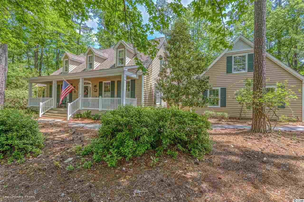 Whether you are a nature lover, a boating enthusiast, or a golfer, you will enjoy the beautiful ambience of historic Wachesaw Plantation in quaint Murrells Inlet, SC. Situated on a large wooded corner lot in this gated private golf course community, this charming, traditional style home has 3 BR and 2.5 baths. Features include large southern front porch, master bedroom on first floor, a formal dining room (or office/study), spacious living room with fireplace and 2 sets of double French doors leading to a wonderful, huge sunroom surrounded with windows!  The kitchen has built-in ovens and a large island with range plus a dining area. Bright and light laundry room. Side-entry Double garage (2 single doors). HVAC system only 2 years old and roof only 6 years old. Freshly painted inside. Hardwood floors in kitchen, dining, and living area. Carpeted bedrooms and tile in baths and laundry. Remaining furnishings are negotiable. Convenient location close to marina, hospital, specialty medical complexes, Murrells Inlet Marshwalk, great seafood restaurants, beaches, and Brookgreen Gardens. Unmatched views of the Intracoastal Waterway/Waccamaw River, 100 year old moss-hung live oaks in this highly sought-after subdivision, and just over an hour to Charleston to the south and just 30 minutes to Myrtle Beach to the north!