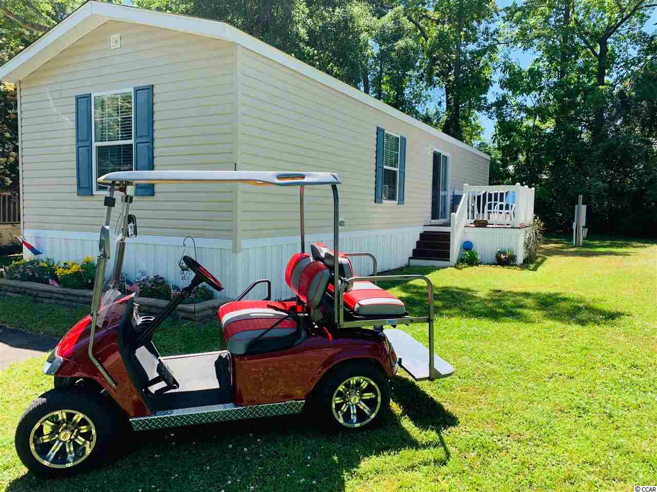 """(( GOLF CART INCLUDED )) This is a VALUE PACKED PROPERTY! Located in the heart of Garden City, and ONLY 1.6 MILES to the Atlantic Ocean, this home offers quick access to the beach by car, golf cart, or bike, and restaurants at your fingertips! Manufactured in 2015, this unit provides you with """"Worry Free Living"""" and minimal maintenance. ALL KITCHEN APPLIANCES, WASHER/DRYER, OUTSIDE STORAGE SHED/WORKSHOP, AND ALL FURNITURE INCLUDED - ((EXCEPT)), the 2 bedroom suits, TV and TV stand, the 2 lamps in living room, white chest cabinet in kitchen, and the planters beside sliding glass door. All other Furniture, Kitchen appliances, and washer/dryer convey. Storage Shed/Workshop and Golf Cart Shed also convey! New owner must complete and qualify for lot lease agreement. No rentals allowed in Windjammer. All measurements are approximate and not guaranteed. Buyer responsible for verification.  Looking to live close to the beach without the cost? This may be the right fit for you! Lock in a showing today!"""