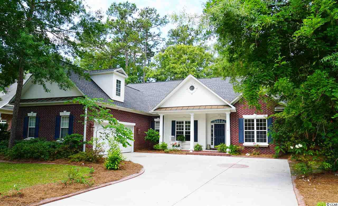 Located in Brookhaven at Blackmoor on the 3rd tee of Blackmoor Golf Course, this 3 bedroom, 2.5 bath brick home is a southern charmer with an open floor plan and lots of custom upgrades! Roof replaced in January 2019. HVAC new in 2018! HUGE Master Suite with double French doors, Travertine tile, soaring triple tray ceiling and Master Bath with garden tub, shower, double vanity and large his and her walk-in closets. Extra large upstairs bonus room with closets and 3 skylights can easily be a 4th bedroom. 10 foot ceilings and ceiling fans throughout home, lots of natural light, gas fireplace, and polished laminate wood downstairs. Formal dining area, cozy den/ library that can easily be made into an office. Roomy separate laundry room, attached 2 car garage with removable wall and a great workshop that can be used for woodwork or crafting. Screened in back porch overlooks the golf course and has 2 ceiling fans, with an additional patio for grilling or outdoor furniture setup, wired for a hot tub. Corian countertop and TONS of cabinet space in the kitchen, cozy breakfast nook and breakfast bar. LARGE walk in pantry. Guest bedrooms are connected by Jack and Jill full bath. Located minutes from all Murrells Inlet has to offer, including the Marshwalk, shopping, dining and entertainment. Call today!