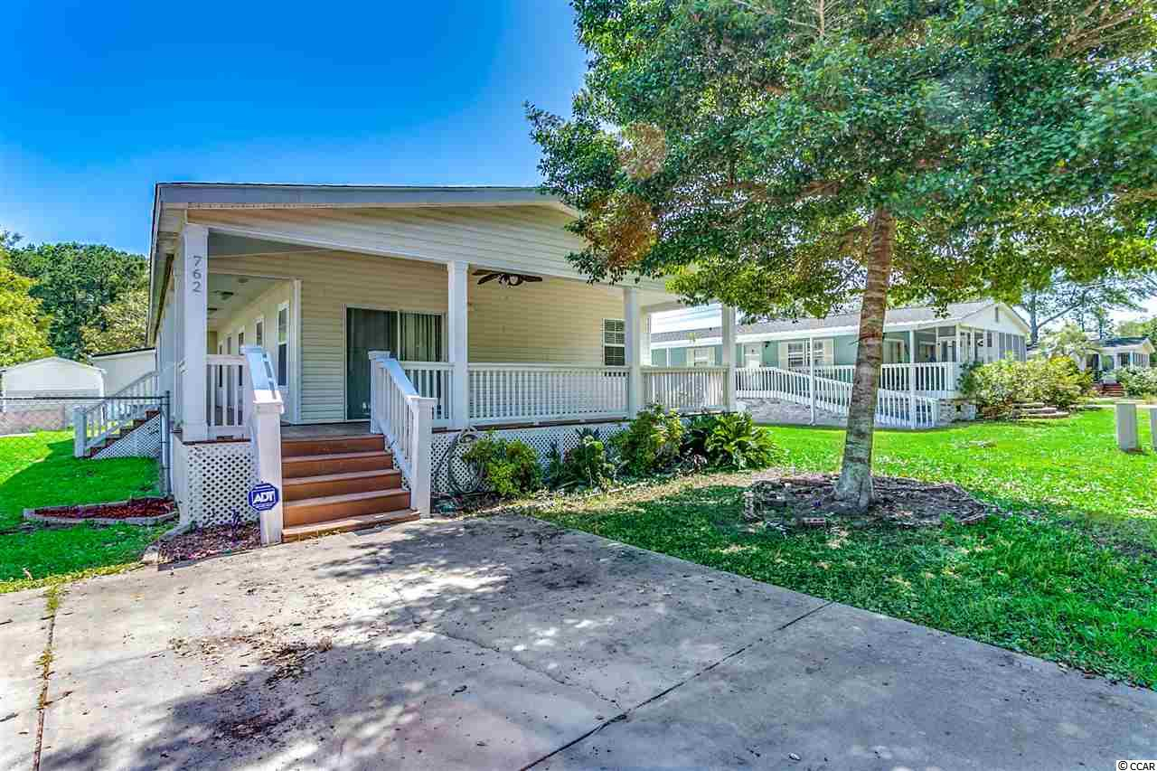 Amazing Find!! This fabulous and immaculate 3 bedroom and 2 bath home is located less than 1 mile from the Atlantic and beautiful beaches. Only a short golf cart ride or evening walk to the ocean where you can enjoy the beautiful sunrises and sunsets. Enjoy the spacious open floor plan with tons of natural light. A large kitchen with plenty of cabinets and counter space to suit all your needs. Split bedroom plan with 3 large bedrooms, and the master suite featuring an enormous walk in closet and sliding glass door that leads to the front porch. The master bath offers a separate shower, whirlpool tub, and double sink. You'll love sitting outside on your wrap around porch or the back deck while enjoying your morning coffee or evening cocktails. The perfect beginning and end to your day! Don't miss the opportunity to have your very own piece of paradise that is perfectly located so close to the beach, restaurants, entertainment, grocery stores, and so much more! Schedule your showing today!