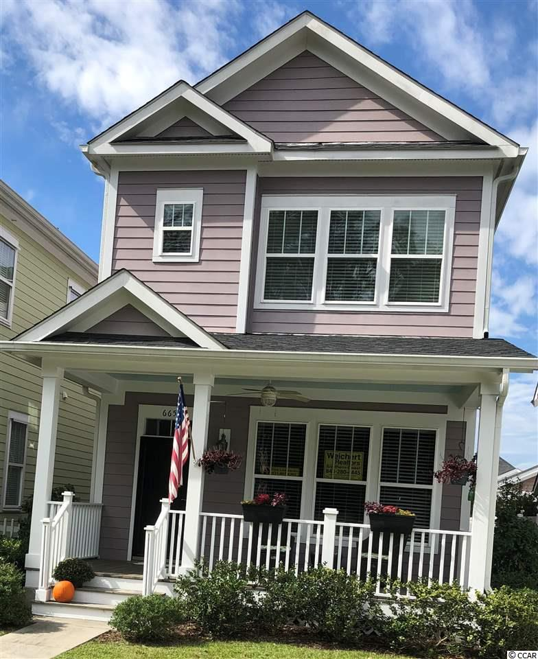 This is the only Manchester model built in the Sweetgrass Square neighborhood at Market Common.  Immaculate home featuring granite, wood flooring, stainless steel appliances and upgraded cabinets with a custom tile backsplash in the kitchen. TWO Master Suites with TWO full baths!  Other features include a fire suppression system, gutters, blinds on all windows, and an alarm system.  Although 2 bedroom with a den, the den can easily be converted to a 3 bedroom by enclosing the 9.5ft x 14ft loft area.  This home is also equipped with a security system and ring doorbell.